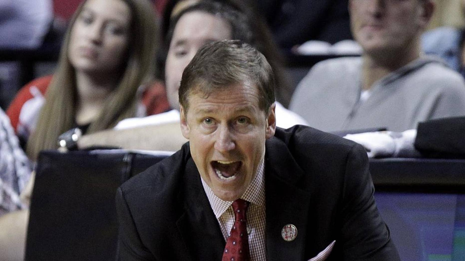 Portland Trail Blazers coach Terry Stotts calls out from the bench area during the second half of an NBA preseason basketball game against Maccabi Haifa in Portland, Ore., Friday, Oct. 17, 2014. The entire Portland roster of 17 players scored as the Blazers won 121-74. (AP Photo/Don Ryan)