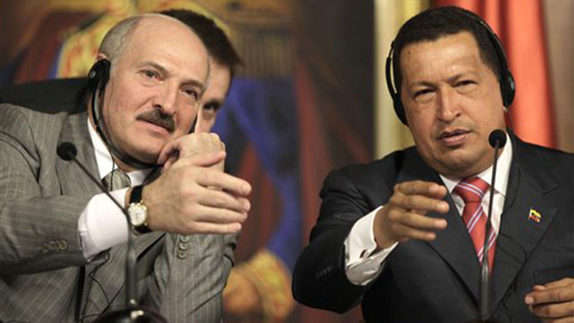 March 17: Belarus' President Alexander Lukashenko, left, and Venezuela's President Hugo Chavez. AP