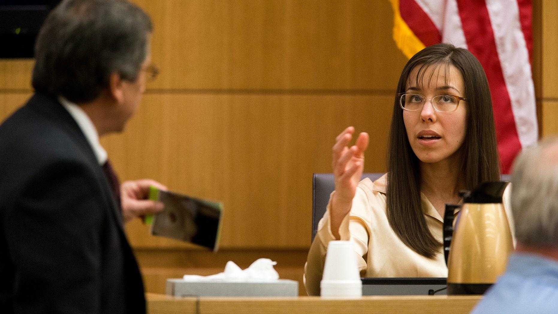 Feb. 26, 2013: Prosecutor Juan Martinez, left, cross examines Jodi Arias a during her trial in Maricopa County Superior Court.