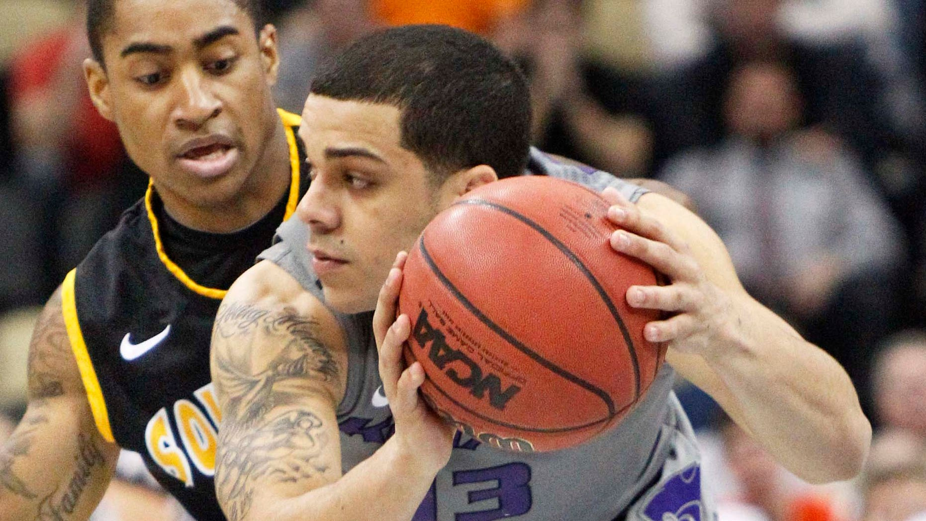Kansas State's Angel Rodriguez (13) gets control of a loose ball in front of Southern Mississippi's Neil Watson, left, defends in the first half of an East Regional NCAA tournament second-round college basketball game on Thursday, March 15, 2012, in Pittsburgh.