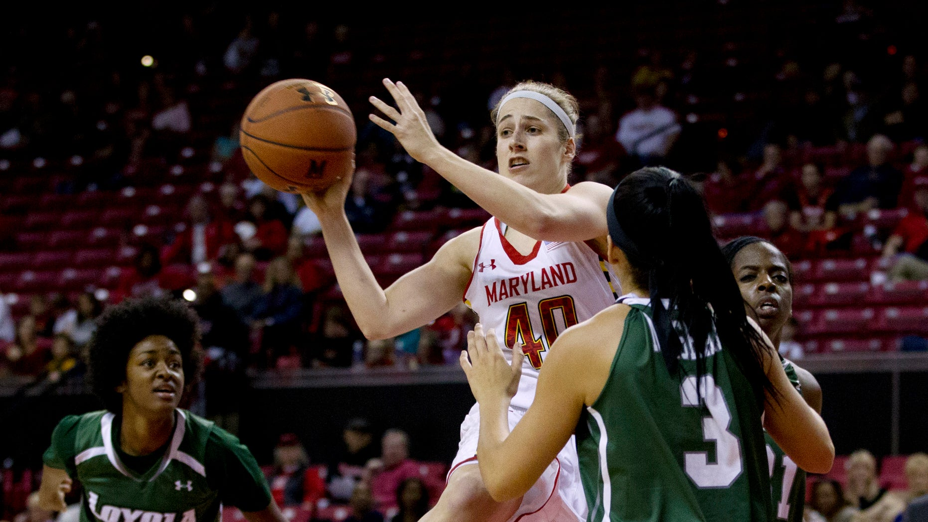 Maryland's Katie Rutan (40) passes the ball during the first half of an NCAA college basketball game against Loyola in College Park, Md., Sunday, Nov. 10, 2013. (AP Photo/Jose Luis Magana)