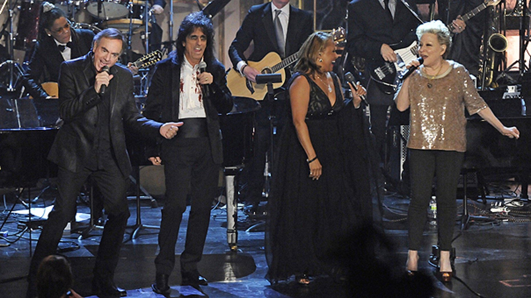March 15: Left to right, Neil Diamond, Alice Cooper, Darlene Love, and Bette Midler perform at the Rock and Roll Hall of Fame induction ceremony in New York.