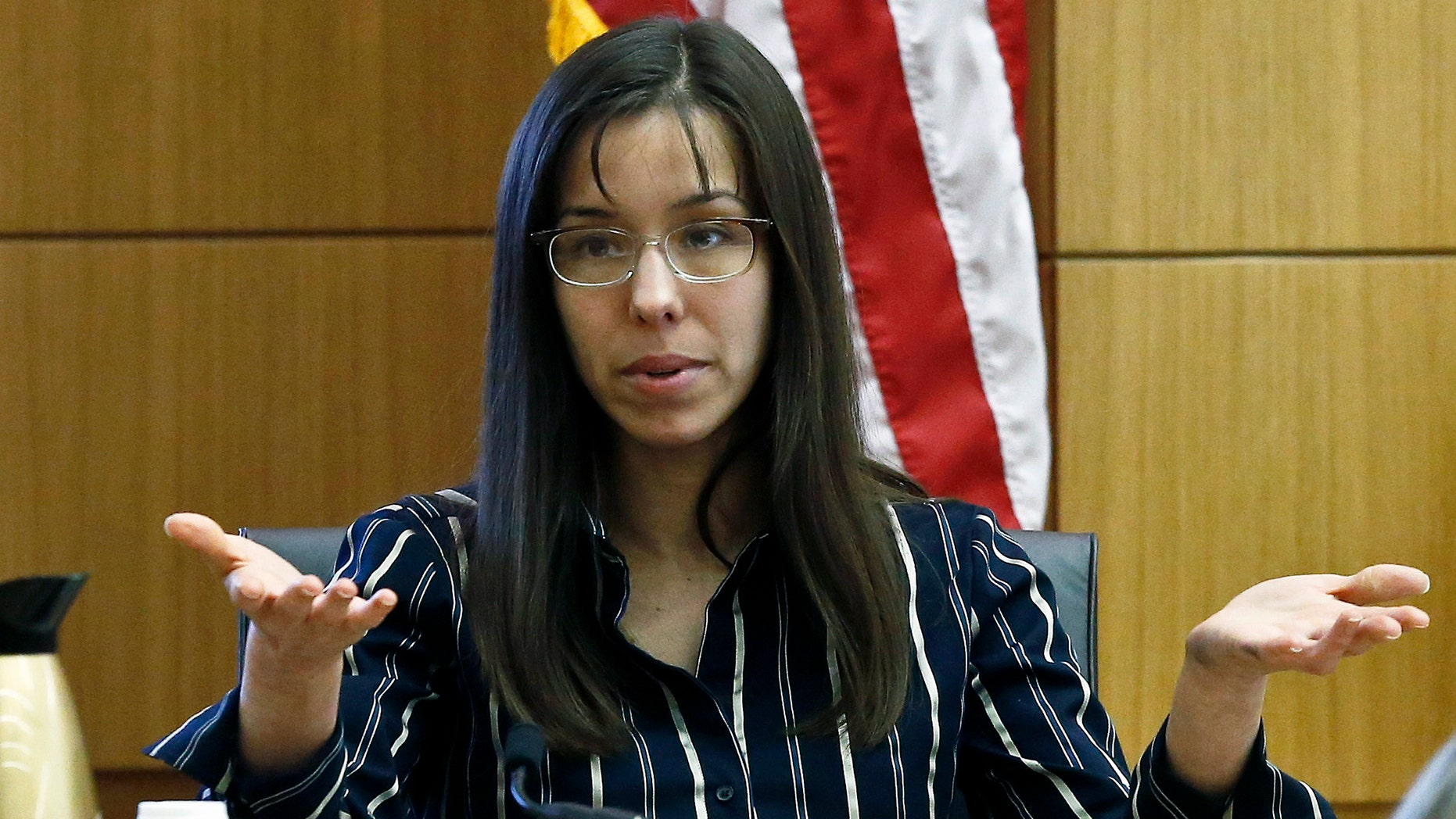 Feb. 13, 2013: Jodi Arias answers a question from one of her attorneys in Maricopa County Superior Court during her murder trial  in Phoenix. (AP)