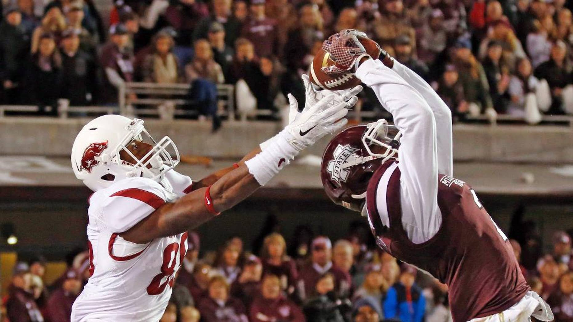 Mississippi State defensive back Will Redmond (2) reaches to intercept a pass intended for Arkansas wide receiver Demetrius Wilson (85) in the end zone in the final seconds of the second half of an NCAA college football game in Starkville, Miss., Saturday, Nov. 1, 2014. No. 1 Mississippi State won 17-10. (AP Photo/Rogelio V. Solis)