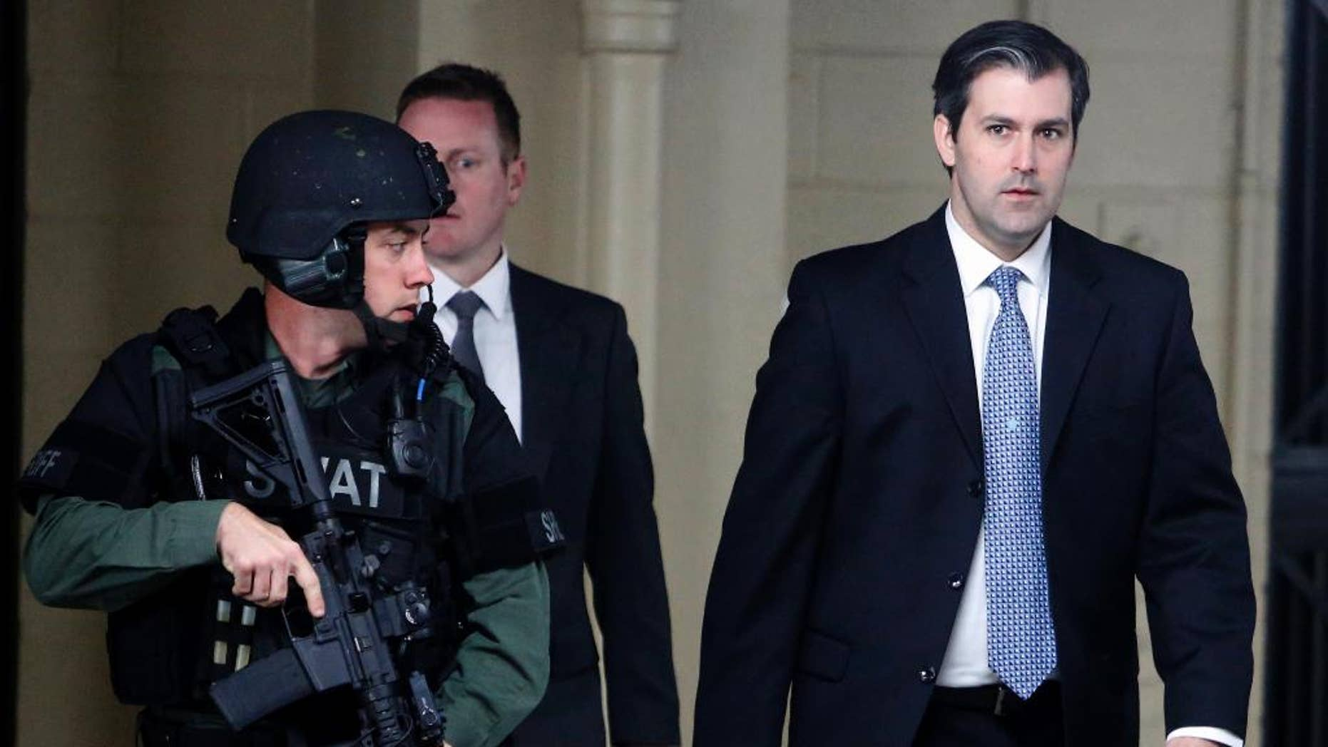 Michael Slager, at right, walks from the Charleston County Courthouse under the protection from the Charleston County Sheriff's Department after a mistrial was declared for his trial Monday Dec. 5, 2016, in Charleston, S.C. Former patrolman, Slager, was charged with murder in the April 4, 2015, shooting death of 50-year-old Walter Scott. (AP Photo/Mic Smith)