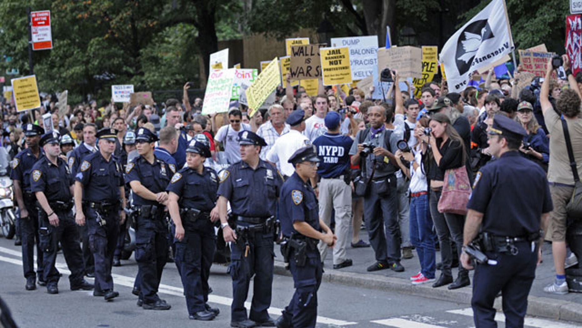 September 30: A several block long crowd of protestors march up Broadway towards Police Headquarters in New York.