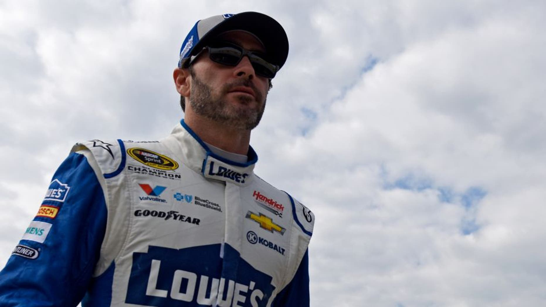HOMESTEAD, FL - NOVEMBER 19: Jimmie Johnson, driver of the #48 Lowe's Chevrolet, walks through the garage area during practice for the NASCAR Sprint Cup Series Ford EcoBoost 400 at Homestead-Miami Speedway on November 19, 2016 in Homestead, Florida. (Photo by Jared C. Tilton/Getty Images)
