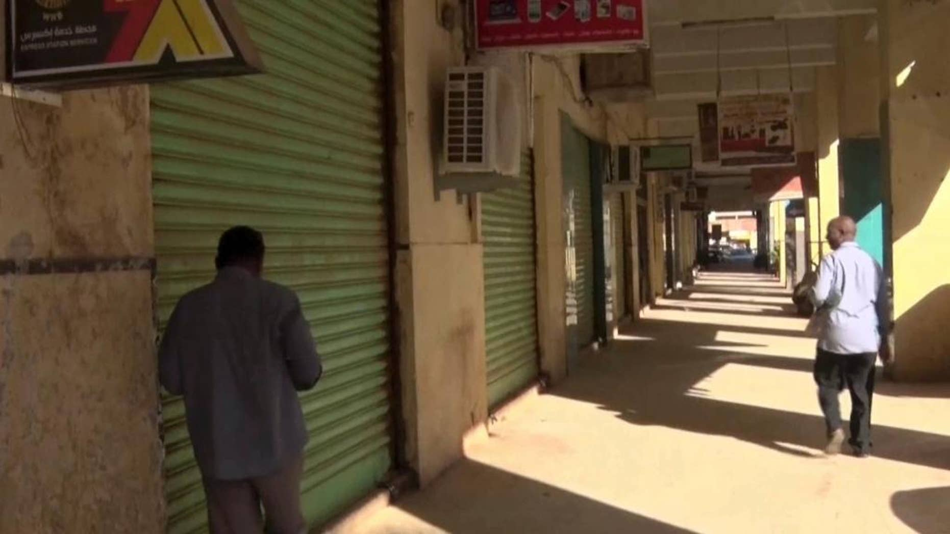 This still image taken from television footage, shows closed shops in Khartoum, Sudan, Tuesday, Nov. 29, 2016. Sudanese authorities have banned three more independent newspapers and seized all copies ahead of distribution as a general strike against fuel subsidy cuts and price hikes continued for the third day. (AP Photo)