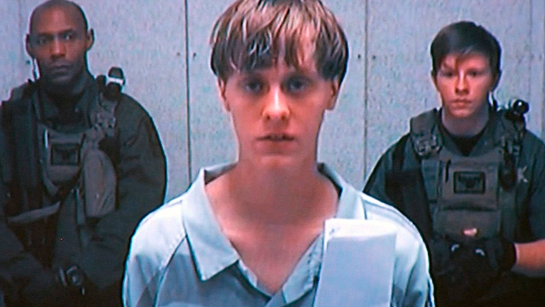 FILE: 2015: Dylann Storm Roof appeared by closed-circuit television at his initial bond hearing.