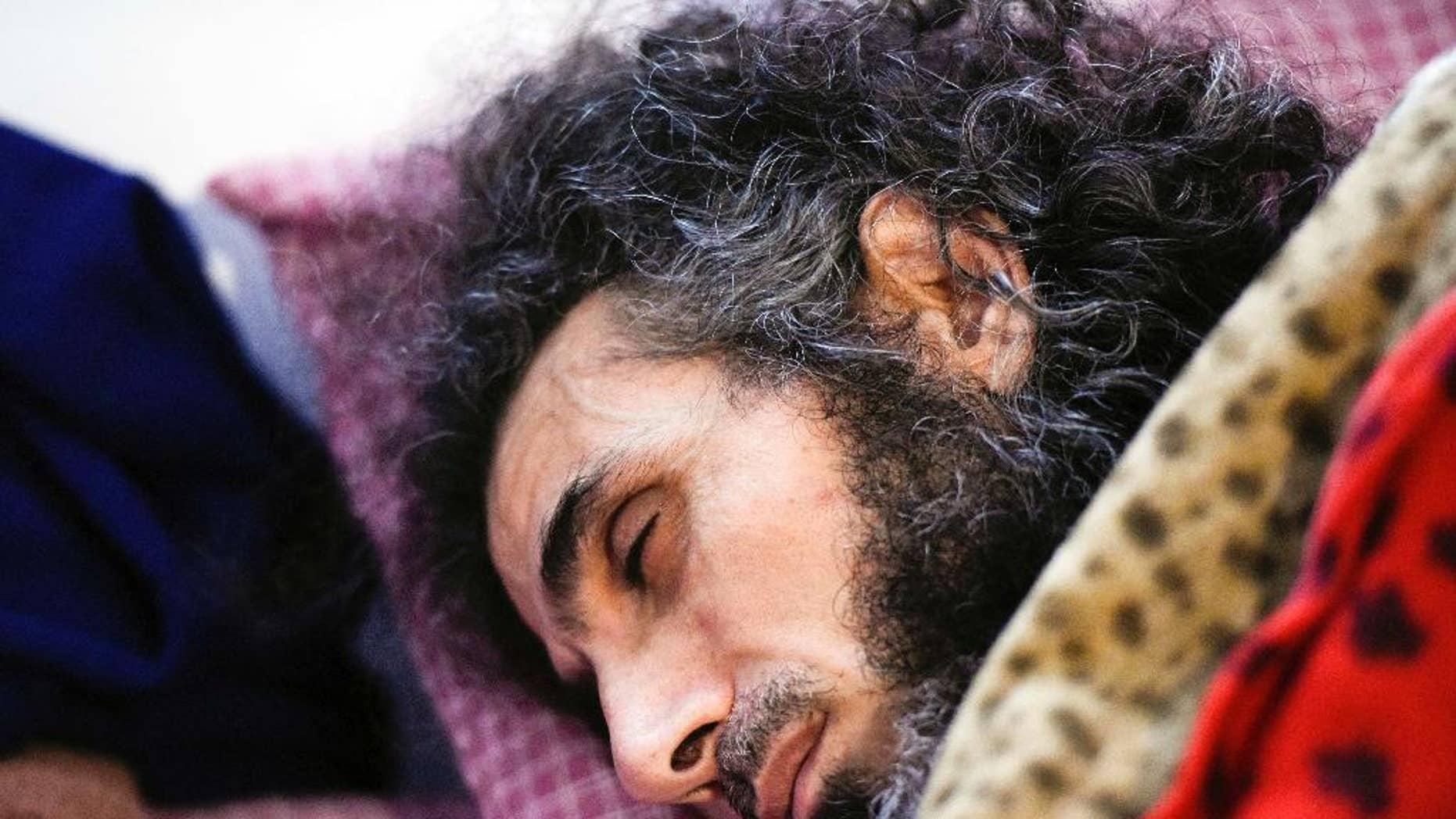 FILE - In this Sept. 9, 2016 file photo, Syrian native Abu Wa'el Dhiab rests in bed while conversing with his family via a laptop, in his apartment in Montevideo, Uruguay. Uruguay's president said on Wednesday, Sept. 21, that Dhiab demands exceed his government's capacity to deliver. (AP Photo/Matilde Campodonico, File)