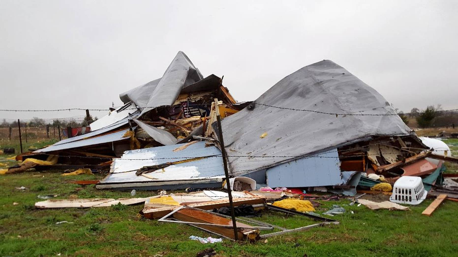 This Sunday, Dec. 27, 2015 photo shows damage to the home where Daniel and Zuleyma Santillano lived with their newborn and three older children in Blue Ridge, Texas, north of Dallas. The Santillano's newborn was killed when the home was destroyed by a tornado Saturday night.  (AP Photo/Reese Dunklin)