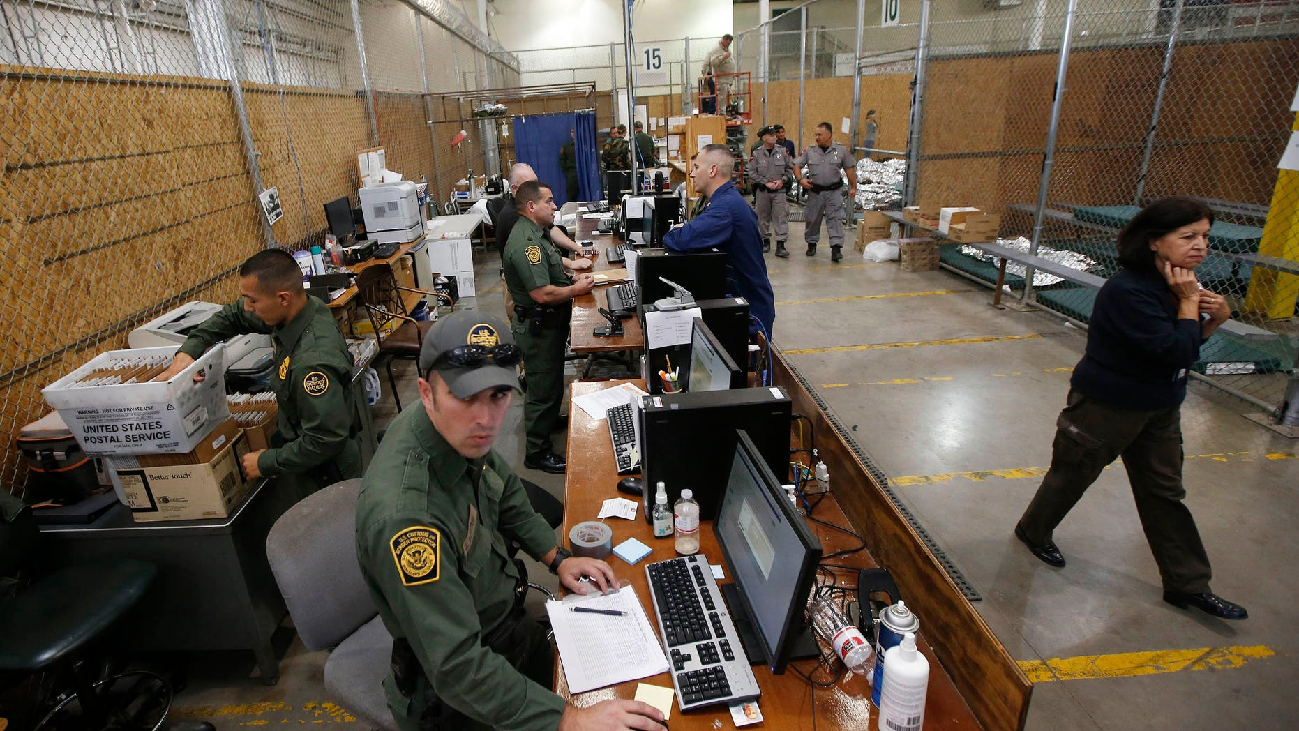 FILE: June 18, 2014: U.S. Customs and Border Protection at the Customs and Border Protection Nogales Placement Center in Nogales, Ariz.