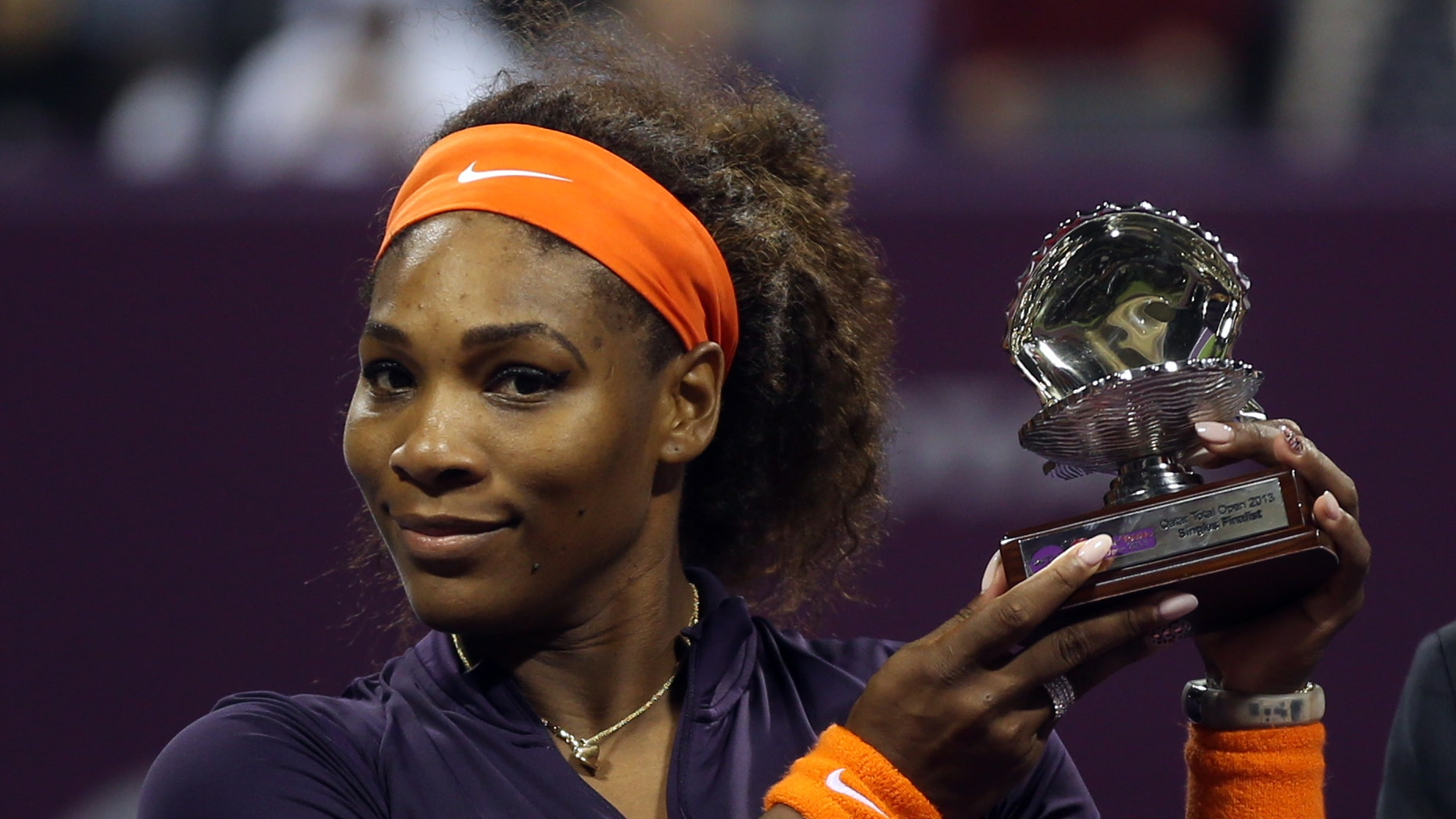 Serena Williams of the U.S.  poses with her trophy after losing to Belarus' Victoria Azarenka in their final match of the Qatar WTA Ladies Open tennis tournament,  in Doha, Qatar, Sunday, Feb. 17, 2013. (AP Photo/Osama Faisal)