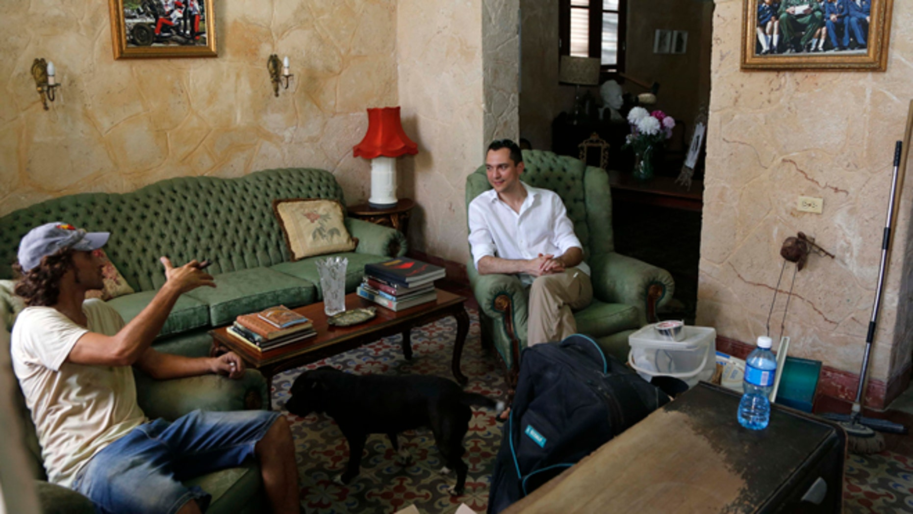 Co-founder of AirBnb Nathan Blecharczyk, right, visits with guesthouse owner Armando Usain in Havana, Cuba, Wednesday, June 24, 2015. AirBnb has added more than 2,000 listings in Cuba, which has long had an extensive network of legal private home for rent to travelers. (AP Photo/Desmond Boylan)
