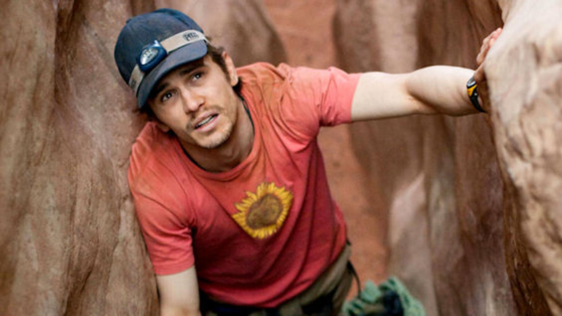 """In this publicity image, James Franco is shown in a scene from """"127 Hours,"""" a film which earned him an Oscar nod. The actor will pursue a PhD from the University of Houston."""