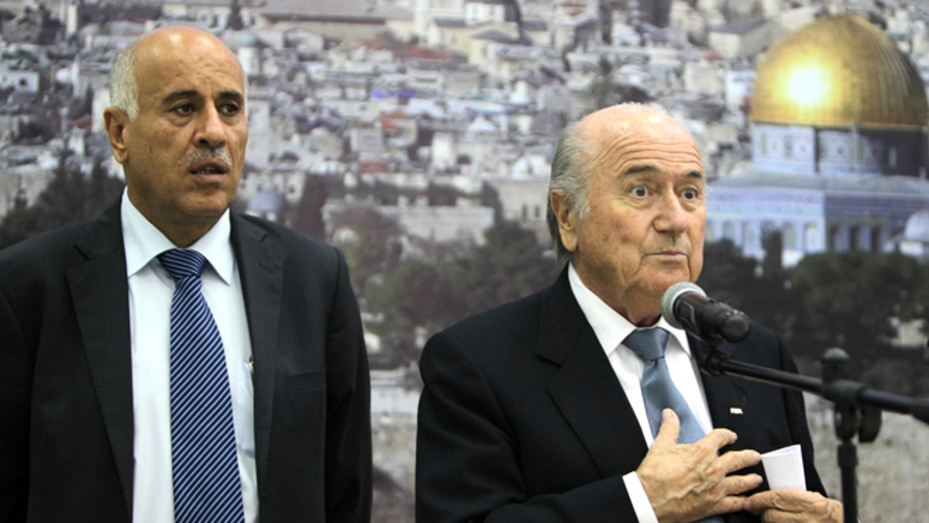 FIFA President Sepp Blatter (R) speaks as Palestinian Football Association chairman Jibril Rajoub listens on during a press conference in the West Bank city of Ramallah on July 7, 2013. Blatter is on a four-day-official visit to the Palestinian territories and Israel and neighboring Jordan during which he will notably launch football turf fields. AFP PHOTO/ABBAS MOMANI        (Photo credit should read ABBAS MOMANI/AFP/Getty Images)