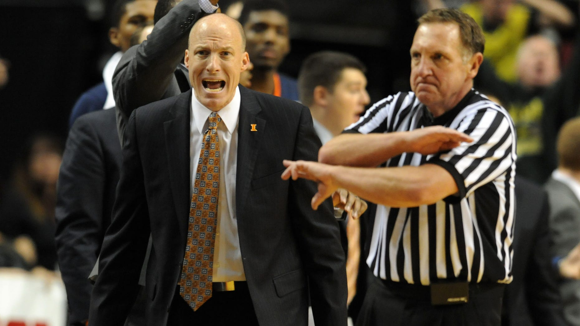 Illinois head coach John Groce, left, yells at an official during the second half of an NCAA college basketball game against the Oregon in Portland, Or., Saturday, Dec. 14, 2013. Oregon won 71-64. (AP Photo/Steve Dykes)