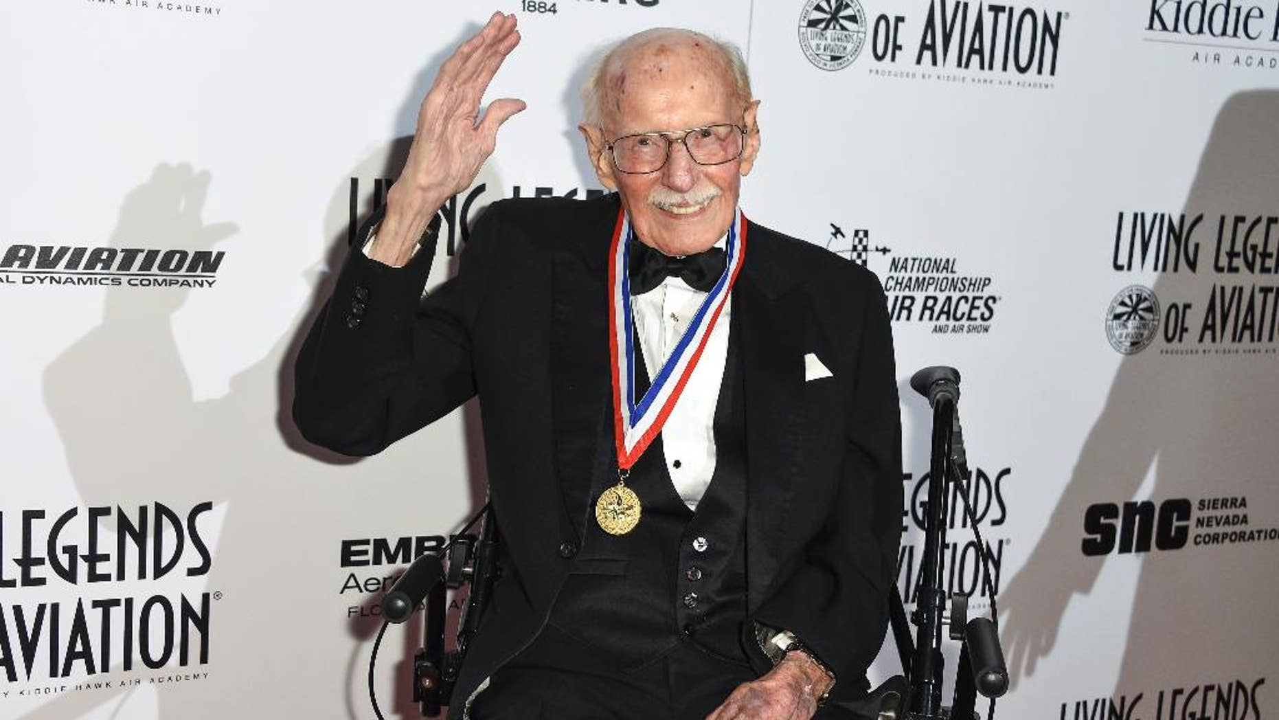 """FILE - In this Jan. 16, 2015, file photo, Bob Hoover attends the 12th annual Living Legends of Aviation Awards at The Beverly Hilton Hotel in Beverly Hills, Calif. Robert A. """"Bob"""" Hoover, a World War II fighter pilot who became an aviation legend for his skills in testing aircraft and demonstrating their capabilities in air shows, has died at age 94. Bill Fanning, a close family friend and a fellow pilot, says Hoover died early Tuesday, Oct. 25, 2016, in Southern California. (Photo by Rob Latour/Invision/AP, File)"""