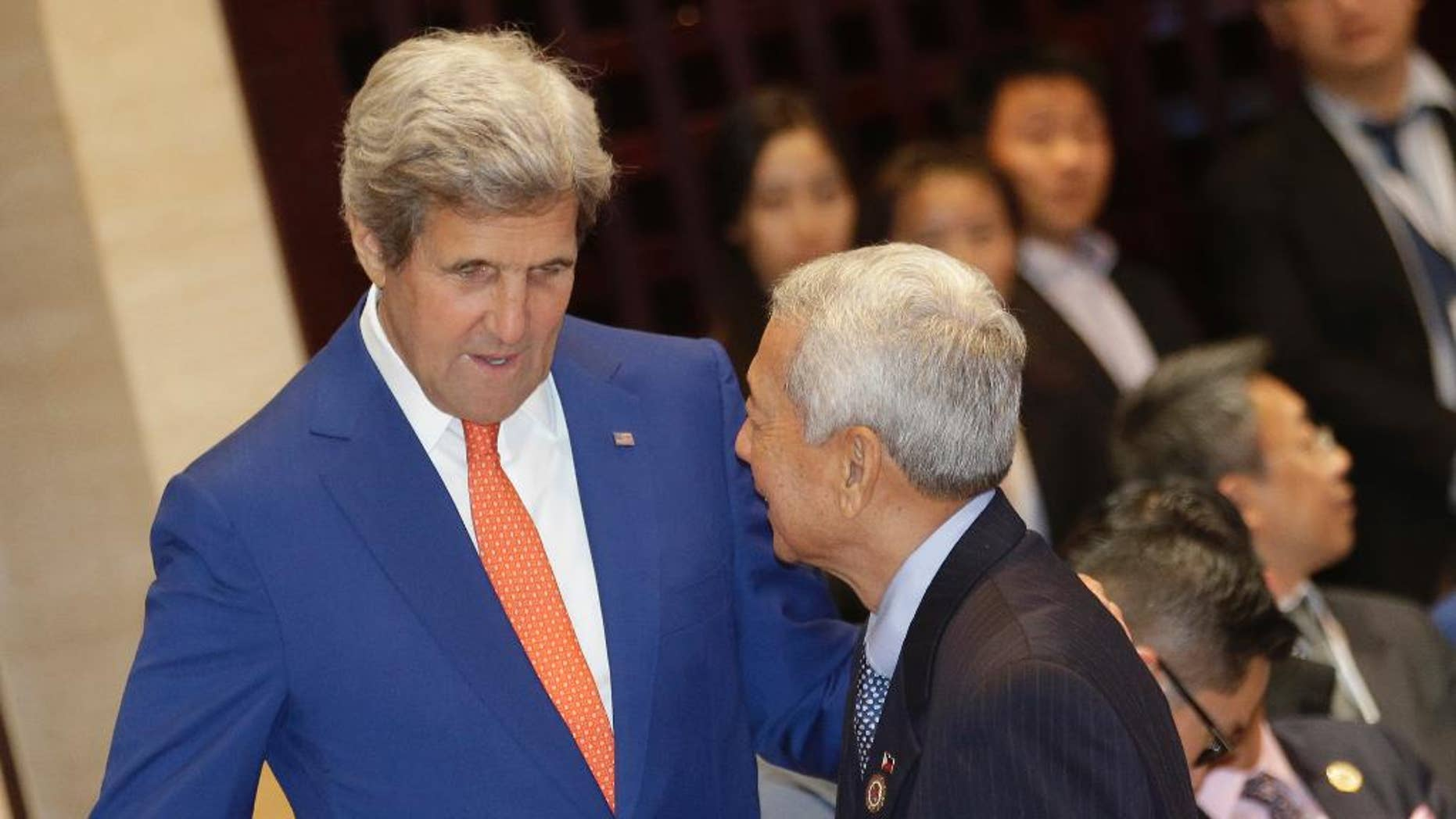U.S. Secretary of State John Kerry, left, talks to Philippine Foreign Secretary Perfecto Yasay Jr. before the Association of Southeast Asian Nations (ASEAN)-U.S. Foreign Ministers Meeting in Vientiane, Laos, Monday, July 25, 2016. Southeast Asia's main grouping made a last-ditch attempt to reach a consensus on countering China's territorial expansion in the South China Sea, but their deadlock appeared far from being resolved as minutes ticked by before a critical meeting with the Chinese foreign minister Monday. (AP Photo/Sakchai Lalit)