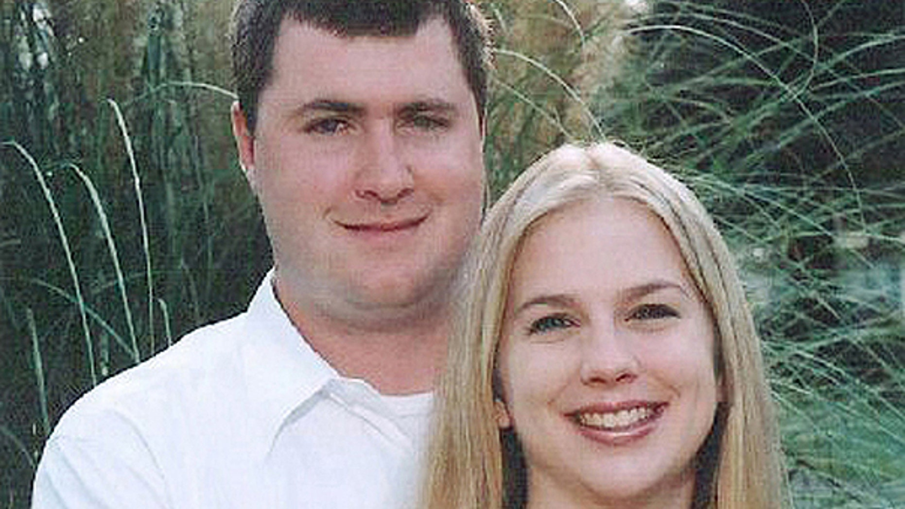 June 20, 2008: Gabe Watson, left, and his wife, Tina, pose on their engagement.