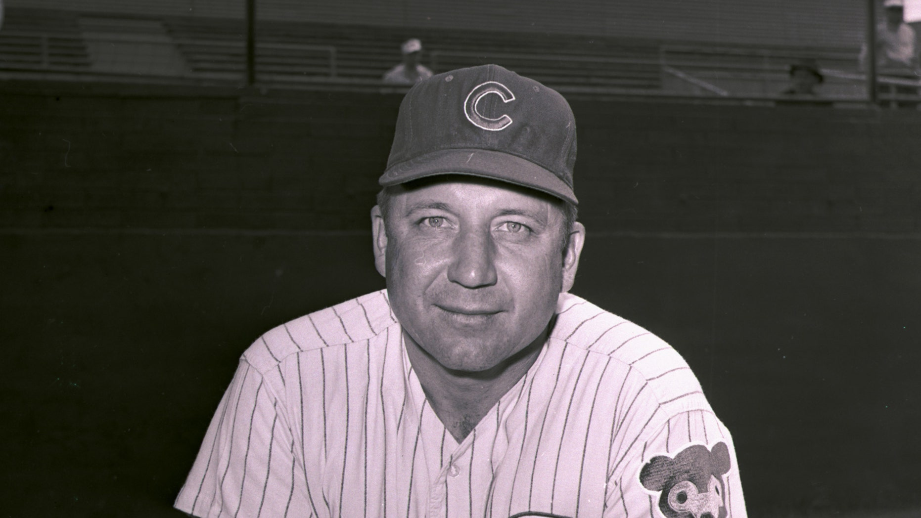 """FILE - This is a March 4, 1964, file photo showing Chicago Cubs coach Verlon Walker. Leigh Ann Young was only 3 when her father, Verlon """"Rube"""" Walker died, a Major League Baseball player whose life cut short by leukemia at the age of 42.  (AP Photo/File)"""