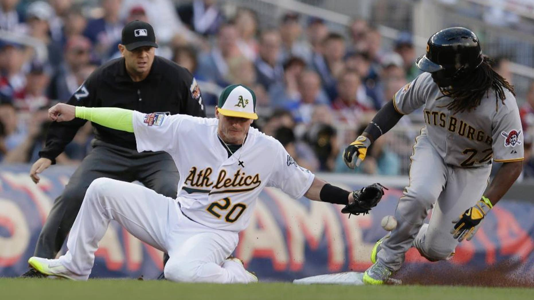 National League outfielder Andrew McCutchen, of the Pittsburgh Pirates, steals third base as American League Josh Donaldson, of the Oakland Athletics, tries to make the tag during the first inning of the MLB All-Star baseball game, Tuesday, July 15, 2014, in Minneapolis. (AP Photo/Jeff Roberson)