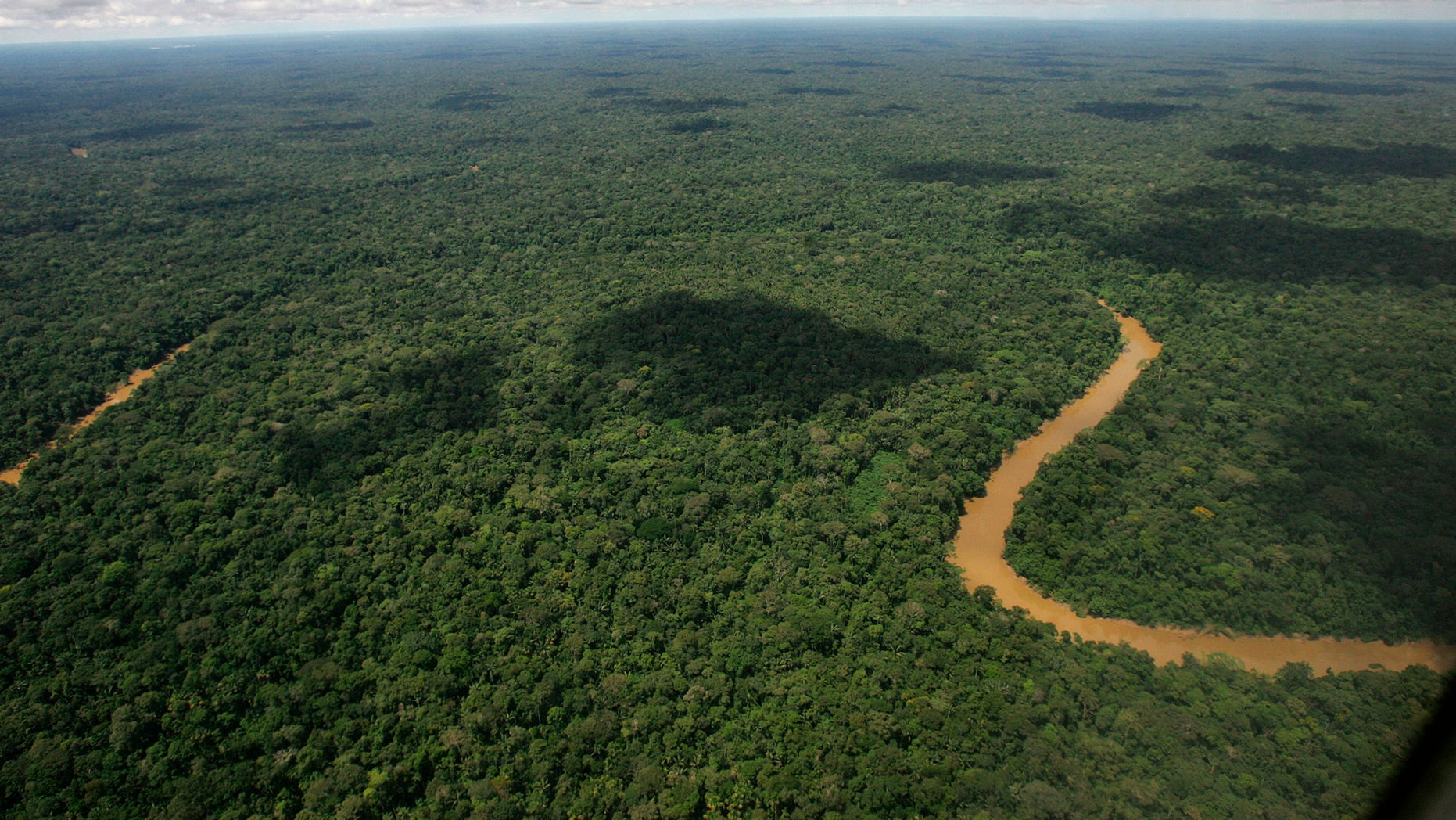FILE - This May 17, 2007 file photo shows an aerial view of Yasuni National Park in Ecuador's northeastern jungle. Lawmakers on Thursday, Oct. 3, 2013 authorized the extraction of oil from Yasuni National Park, a pristine Amazon reserve. (AP Photo/Dolores Ochoa, File)