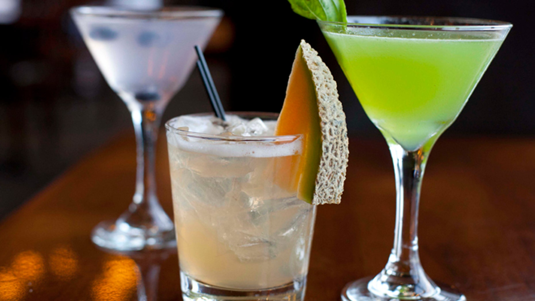 FILE -In this Monday, Nov. 19, 2012, file photo, cocktails are photographed in San Francisco. Airlines have found a way to take the edge off the stress of flying and make a few extra bucks along the way: fancy new cocktails, craft beers and elegant wines.(AP Photo/Eric Risberg)