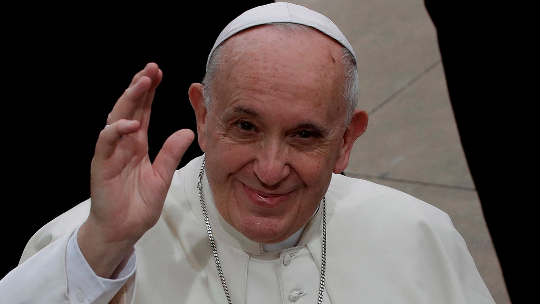 Pope Francis waves during his visit to the parish church of San Paolo della Croce, in Corviale neighborhood, Rome, Sunday, April 15, 2018.