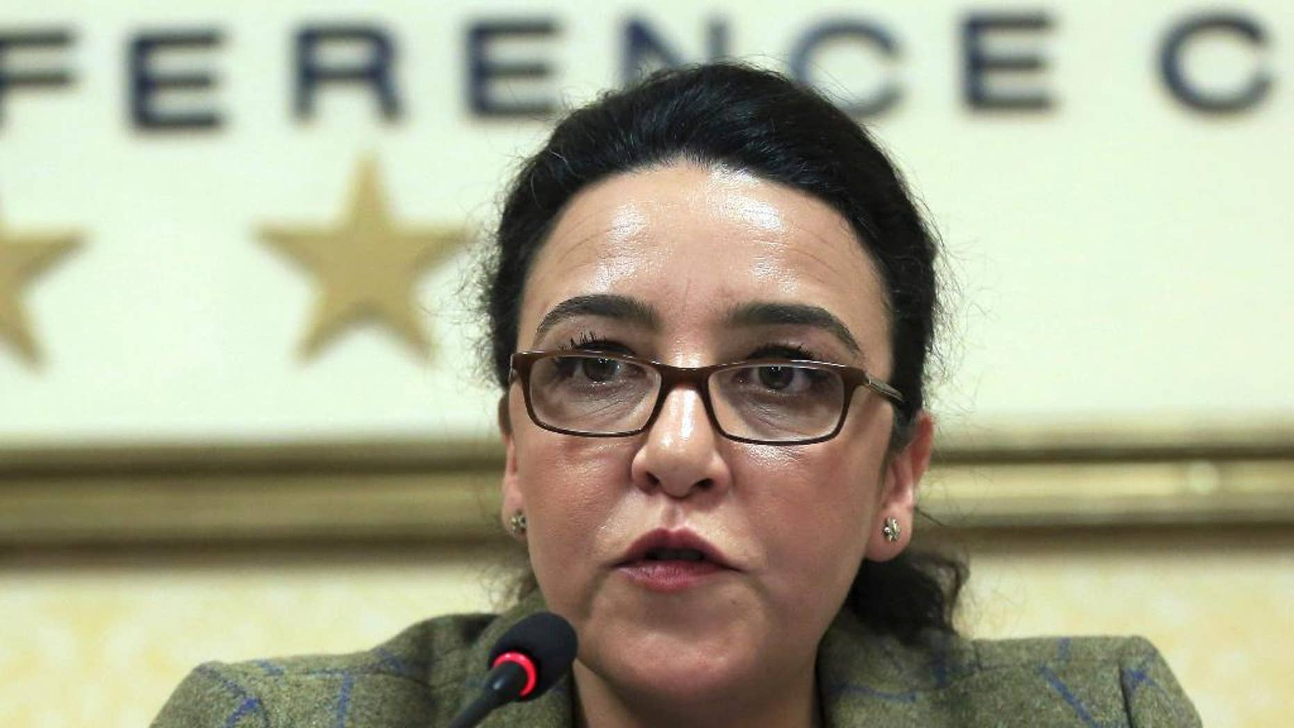 Houria Es-Slami, head of the United Nations Working Group of the Enforced or Involuntary Disappearances, speaks during a news conference in Tirana, Monday, Dec. 12, 2016. U.N. human rights officials have called on Albanian authorities to provide more reparations to families of around 6,000 people who disappeared during the former communist regime. (AP Photo Hektor Pustina)