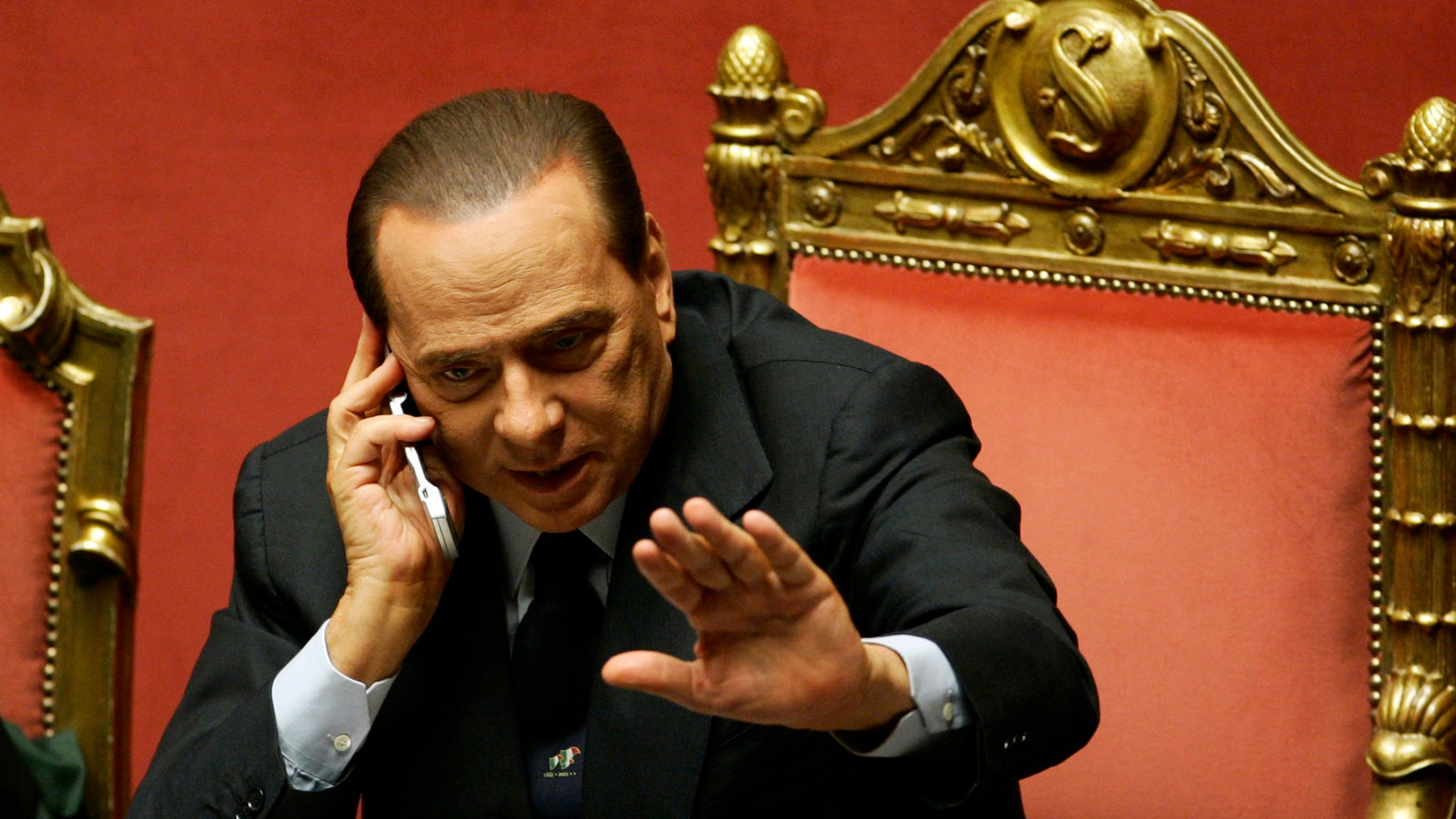 FILE - In this Tuesday, Dec. 14, 2010 file photo, Silvio Berlusconi gestures as he speaks on a mobile phone prior to a parliament debate, at the Senate in Rome, Italy. Berlusconi is among the world leaders who are trying to cope following allegations of massive electronic monitoring by the U.S. National Security Agency (AP Photo/Riccardo De Luca, File)