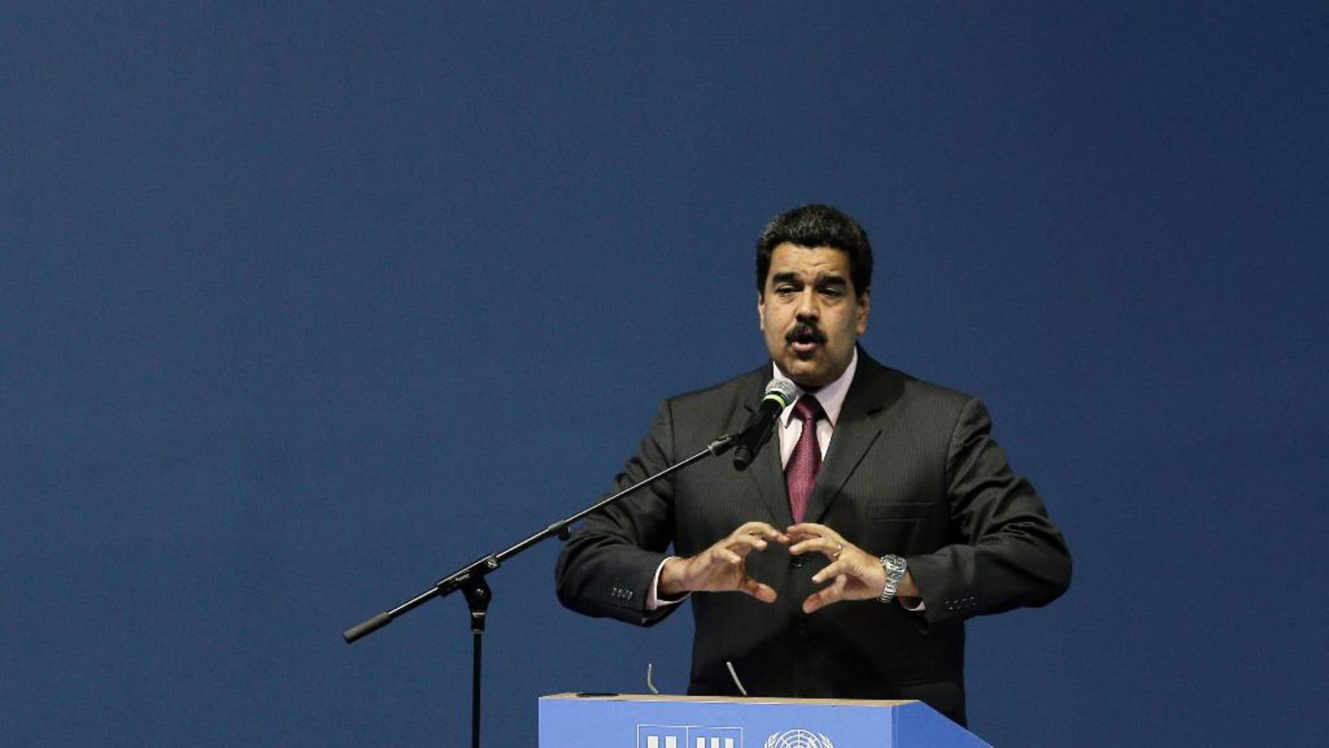 Venezuela's President Nicolas Maduro speaks during the opening of the third United Nations Habitat Conference, in Quito, Ecuador, Monday, Oct. 17, 2016. The meeting kicked off in Quito on Monday with the goal of tackling haphazard growth and fostering livable, self-sustaining cities amid a boom in the global urban population. (AP Photo/Dolores Ochoa)