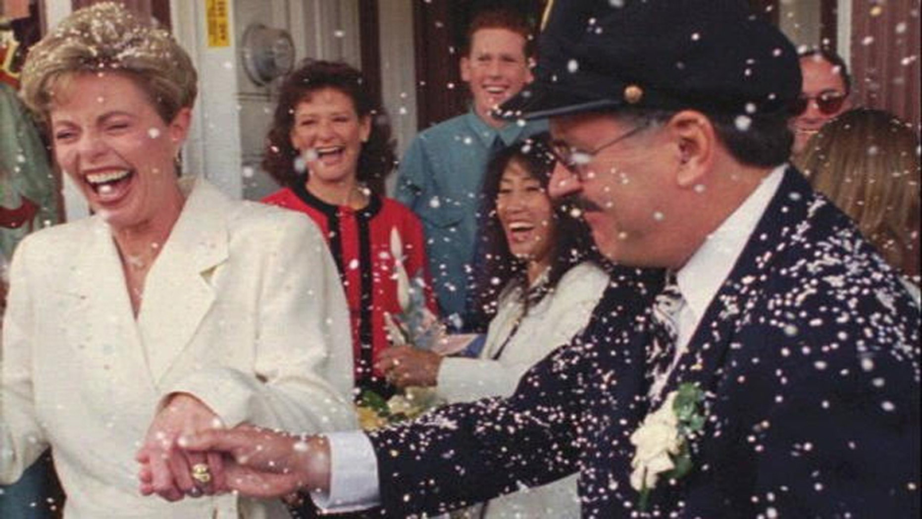 """Toni Tennille (L) and Daryl Dragon singing duo """"The Captain and Tennille"""", after renewing wedding vows in 1995."""