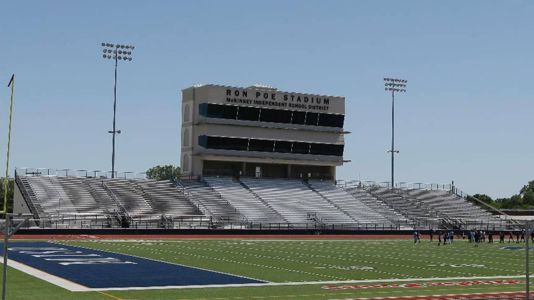 FILE - In this April 28, 2016, file photo, middle schoolers use the field in Ron Poe Stadium in McKinney, Texas. Voters in McKinney Independent School District approved a bond issue Saturday, May 7, 2016, to build a new high school football stadium. (AP Photo/LM Otero, File)
