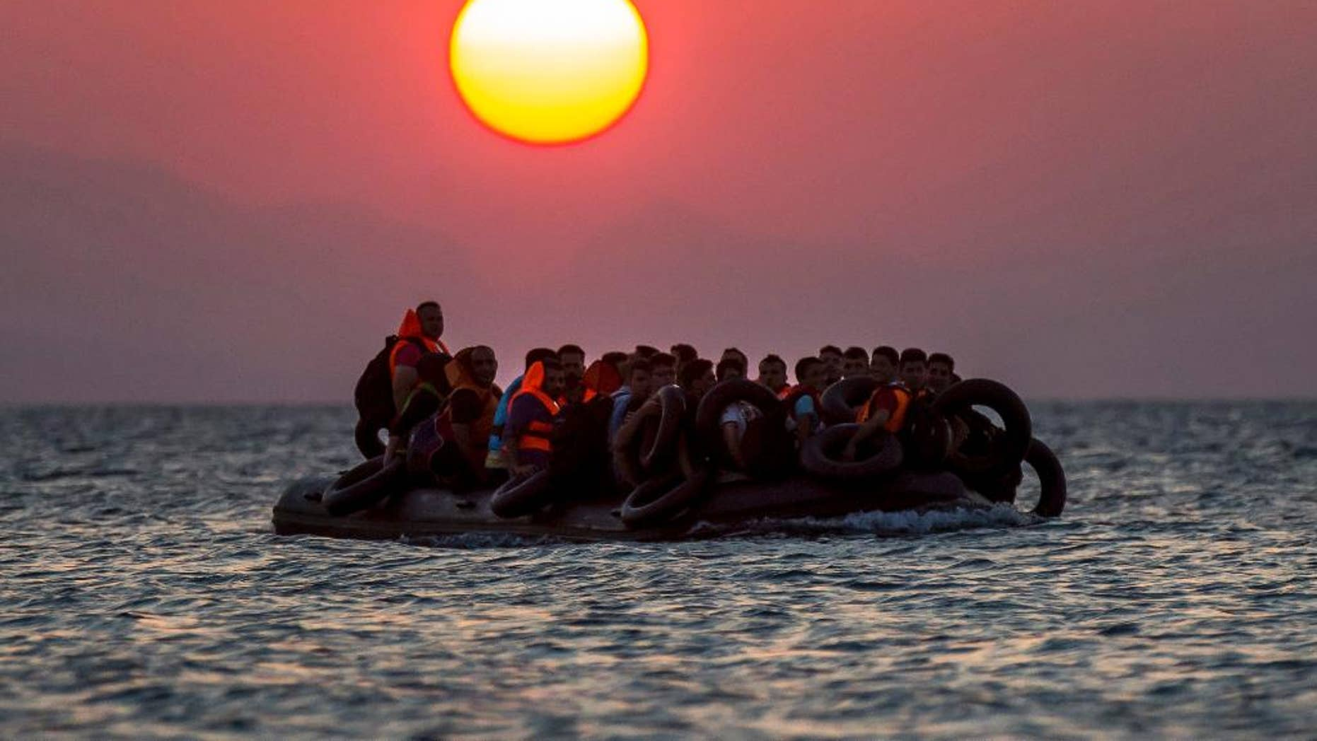 Refugeess on a dinghy approach the southeastern island of Kos, Greece, in August 2015.
