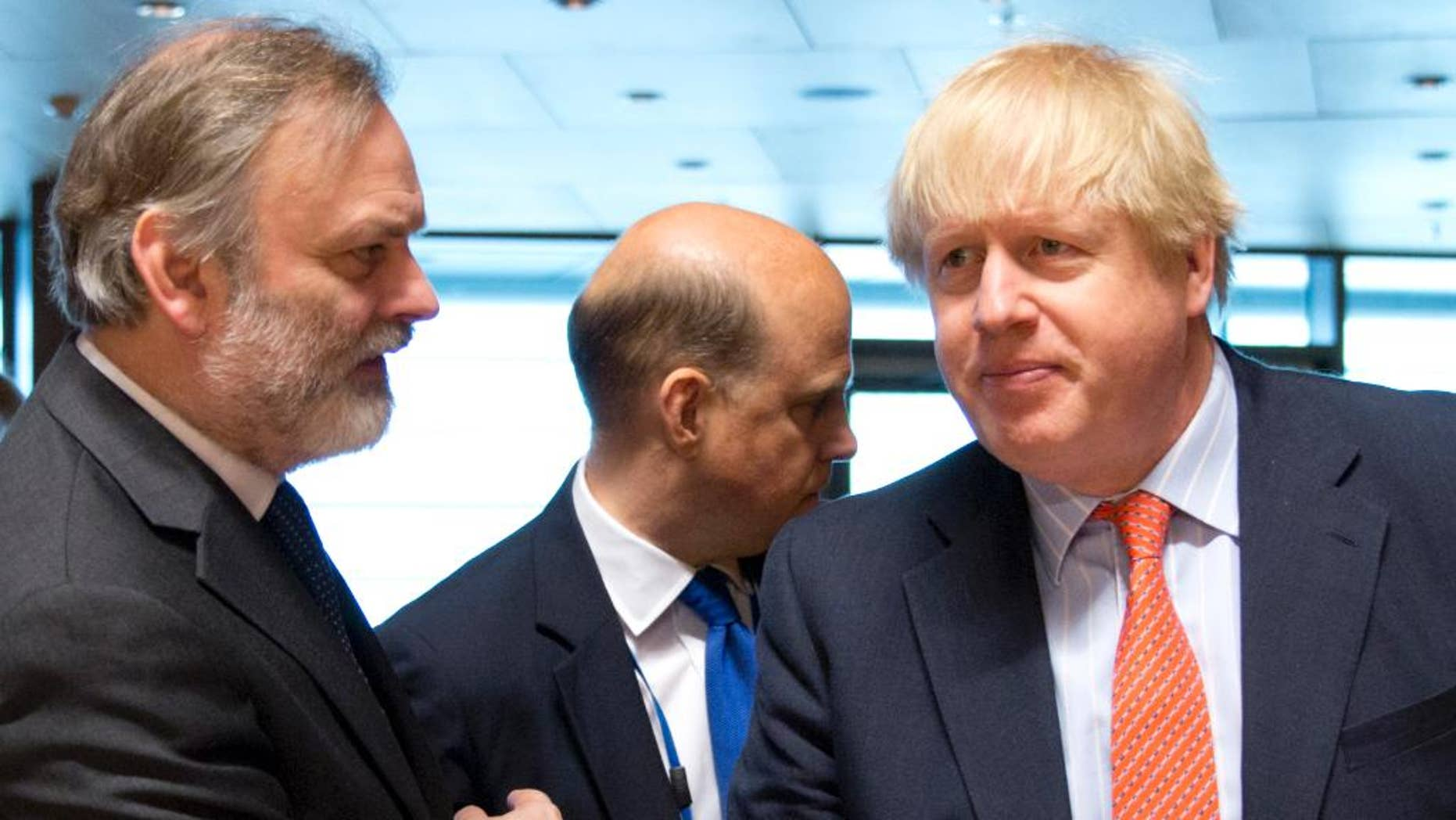 British Foreign Secretary Boris Johnson, right, speaks with the UK permanent representative to the EU, Tim Barrow, during a meeting of EU foreign ministers at the EU Council building in Luxembourg on Monday, April, 2017. European Union foreign ministers meet Monday to discuss the situation in Syria and Libya. (AP Photo/Virginia Mayo)