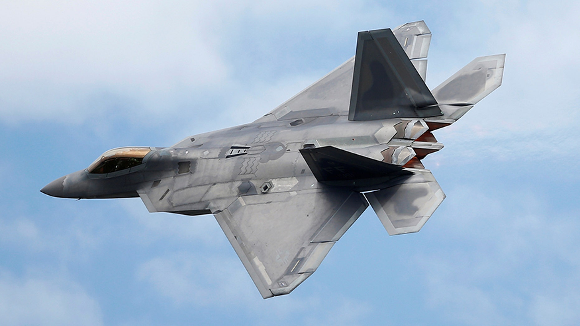 July 8, 2016: A Lockheed Martin F-22 Raptor fighter turns during a flying display in Fairford, Britain.