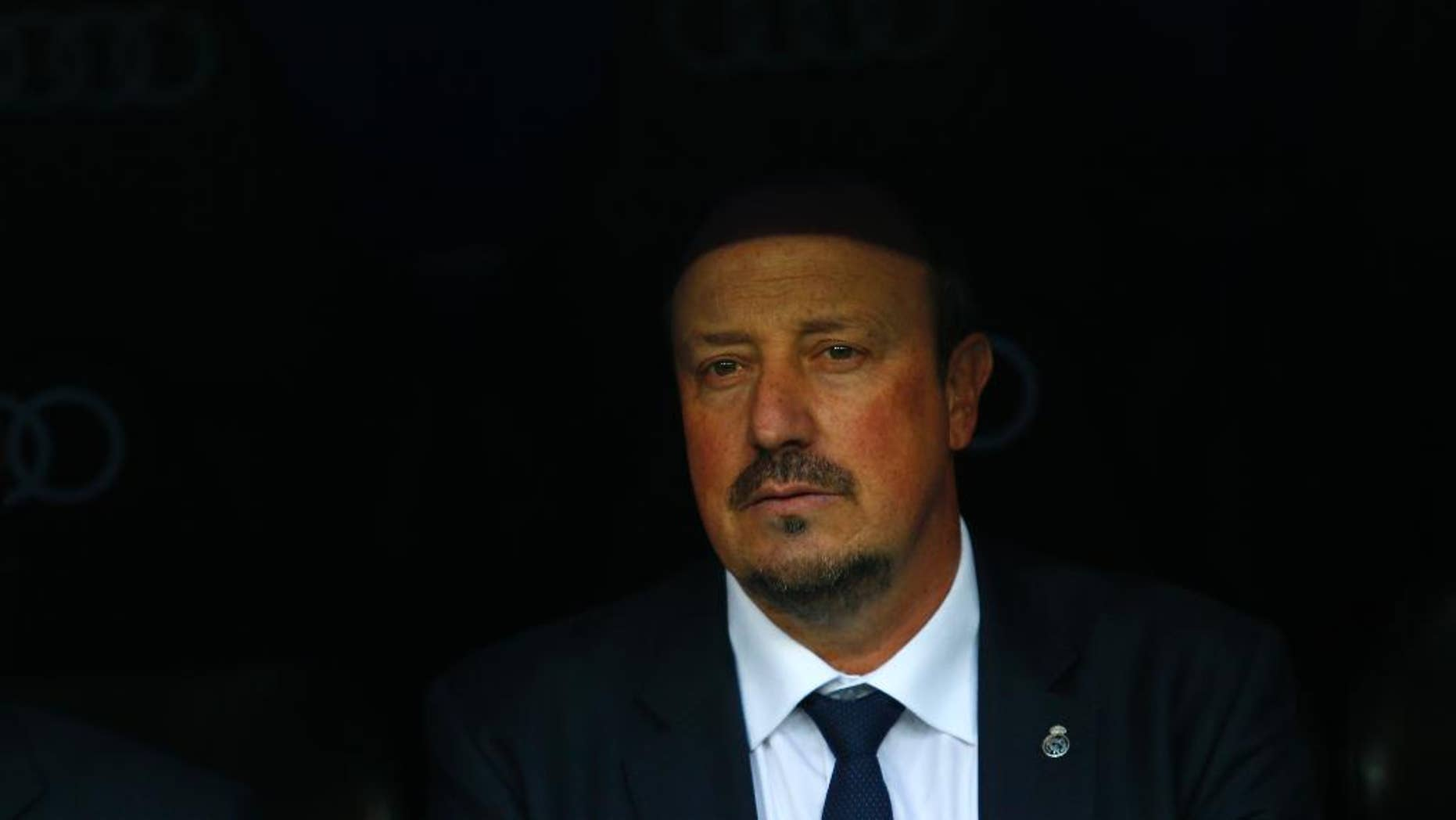 Real Madrid's head coach Rafa Benitez waits for the start of the game during the Spanish La Liga soccer match between Real Madrid and Getafe at the Santiago Bernabeu stadium in Madrid, Saturday, Dec. 5, 2015. Real Madrid won 4-1. (AP Photo/Francisco Seco)