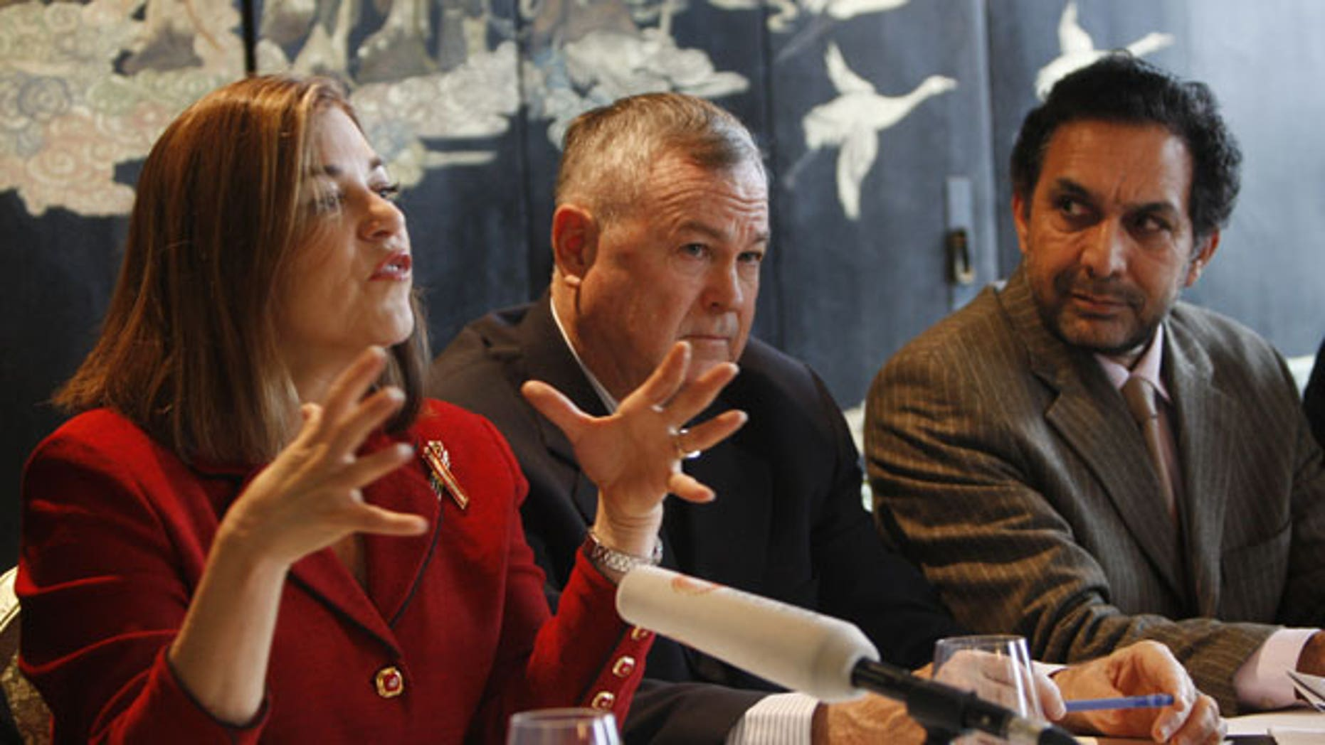 January 9, 2012: Rep Loretta Sanchez, Rep Dana Rohrabacher, Chair of the House Foreign Affairs Subcommittee on Oversight and Ahmad Zia Massoud, Chairman of the National Front, from left, attend a press conference after a meeting of members of U.S. congress with the Northern Alliance Leaders on Afghan Strategy in Berlin.