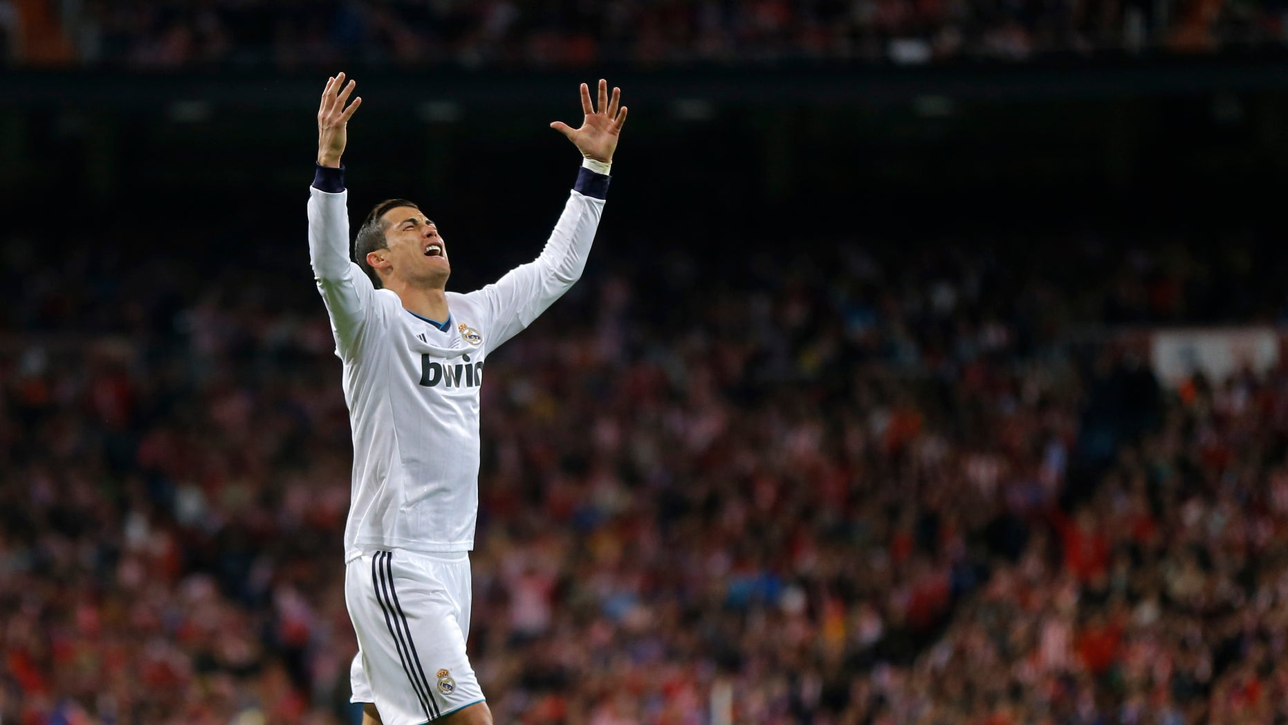 Real Madrid's Cristiano Ronaldo reacts during the Copa del Rey final soccer match between Atletico de Madrid and Real Madrid at the Santiago Bernabeu stadium in Madrid, Spain, Friday, May 17, 2013. (AP Photo/Daniel Ochoa de Olza)