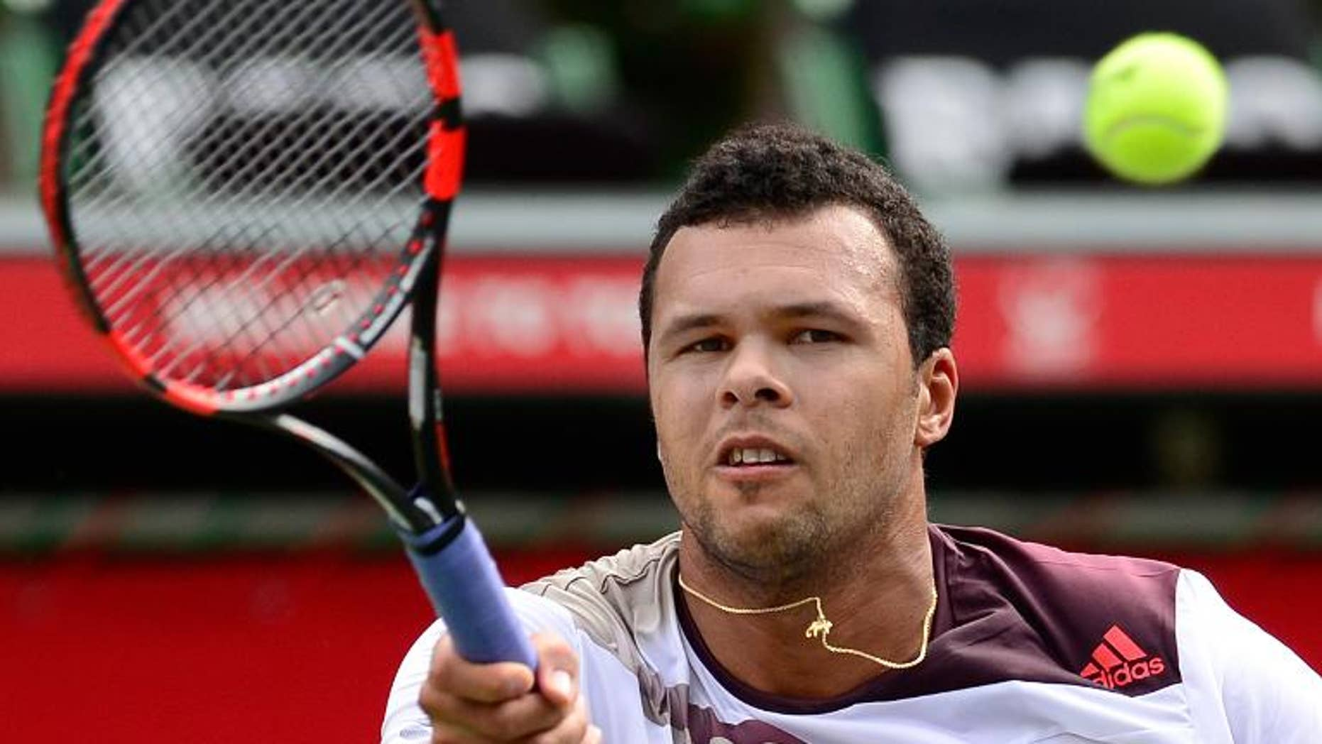 France's Jo-Wilfried Tsonga hits a return against his compatriot Gael Monfils during their first round match Japan Open first round in Tokyo on September 30, 2013. Tsonga defeated Monfils 6-3, 7-6 (10/8).