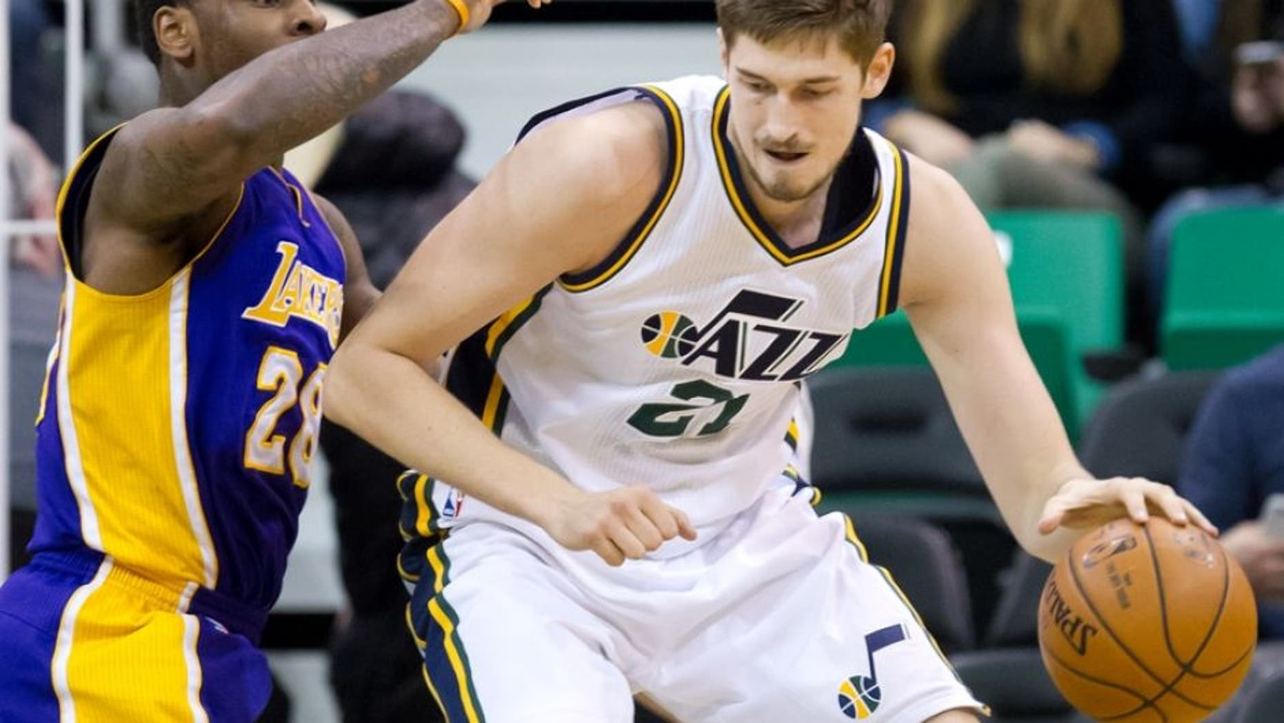 Jan 16, 2016; Salt Lake City, UT, USA; Los Angeles Lakers center Tarik Black (28) defends against Utah Jazz center Tibor Pleiss (21) during the second half at Vivint Smart Home Arena. The Jazz won 109-82. Mandatory Credit: Russ Isabella-USA TODAY Sports
