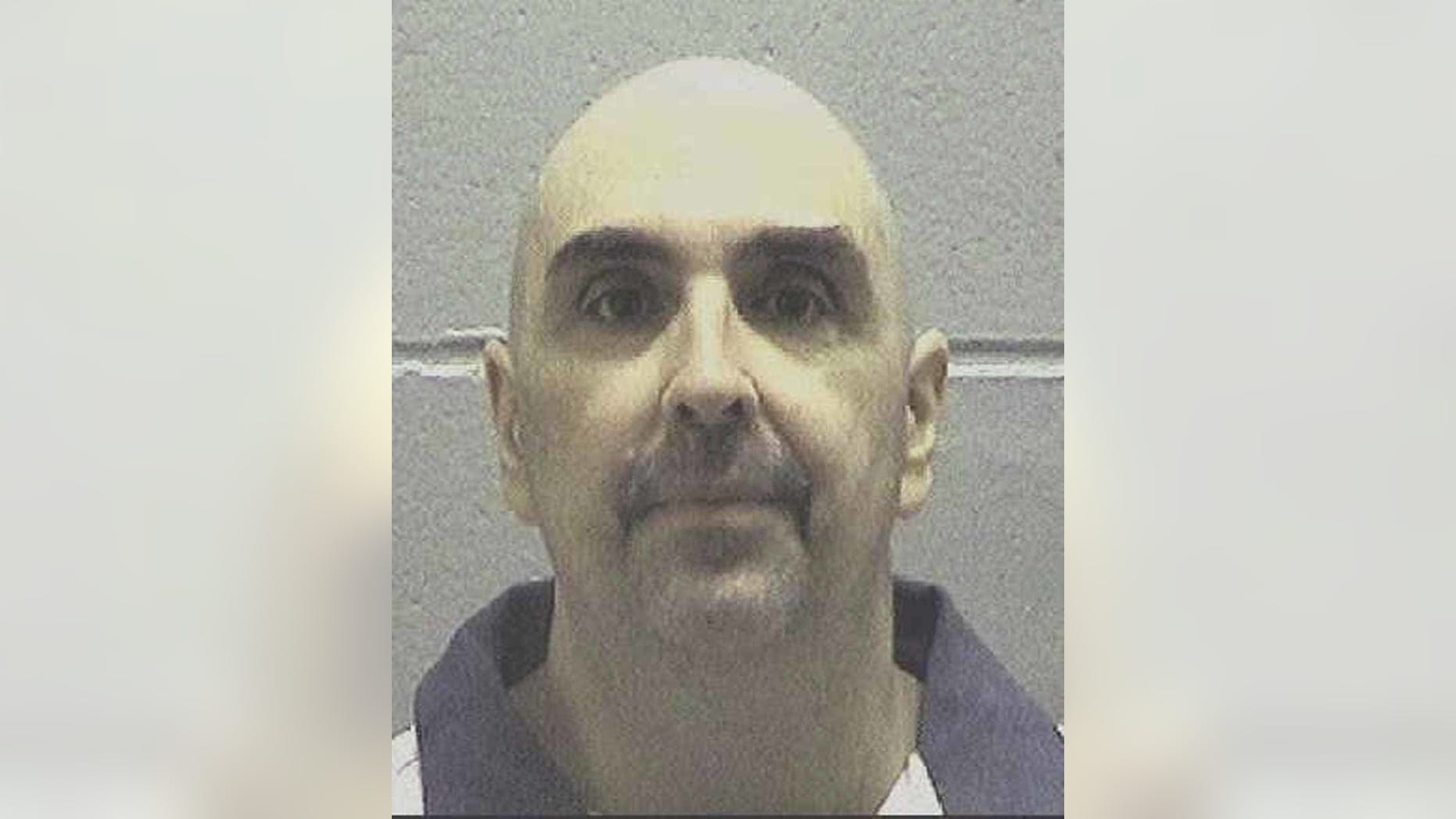 FILE - In this undated photo made available by the Georgia Department of Corrections, shows Steven Frederick Spears. Spears is scheduled to be executed on Wednesday, Nov. 16, 2016. He has refused efforts to spare his life. Spears was convicted of murder in the August 2001 death of Sherri Holland at her home in Dahlonega, GA. (Georgia Department of Corrections via AP)