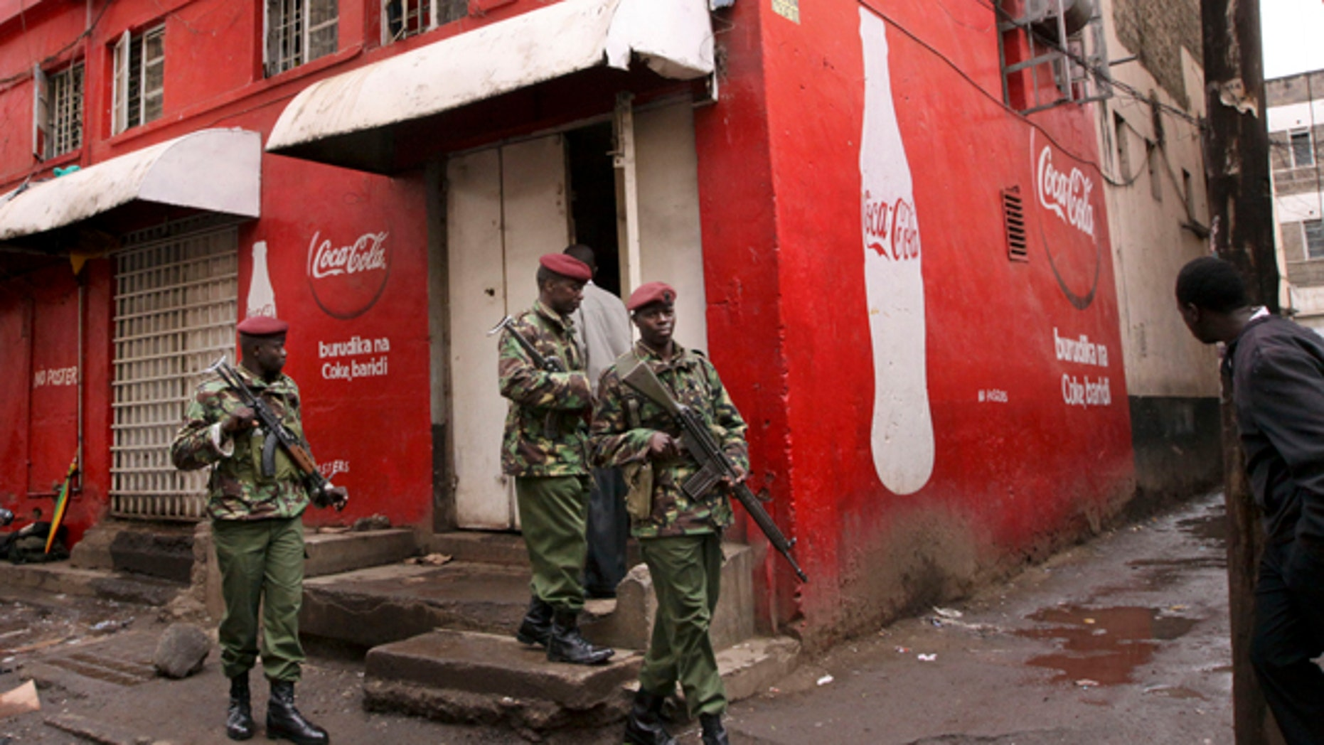 Oct. 24, 2011: Kenyan police patrol outside the pub that was the scene of a suspected grenade blast in downtown Nairobi, Kenya, which a police official said wounded over a dozen people.