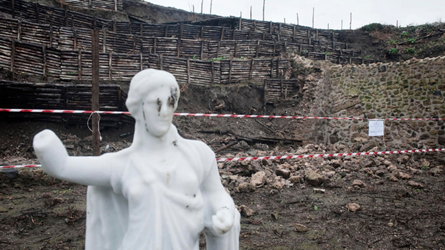 Nov. 30, 2010: A stretch of garden wall ringing an ancient house in Pompeii that gave way after days of torrential rain is cordoned-off. Officials said an inspection found that a 40-foot-long section of wall forming part of the perimeter of a garden area near the House of the Moralist gave way in several points.
