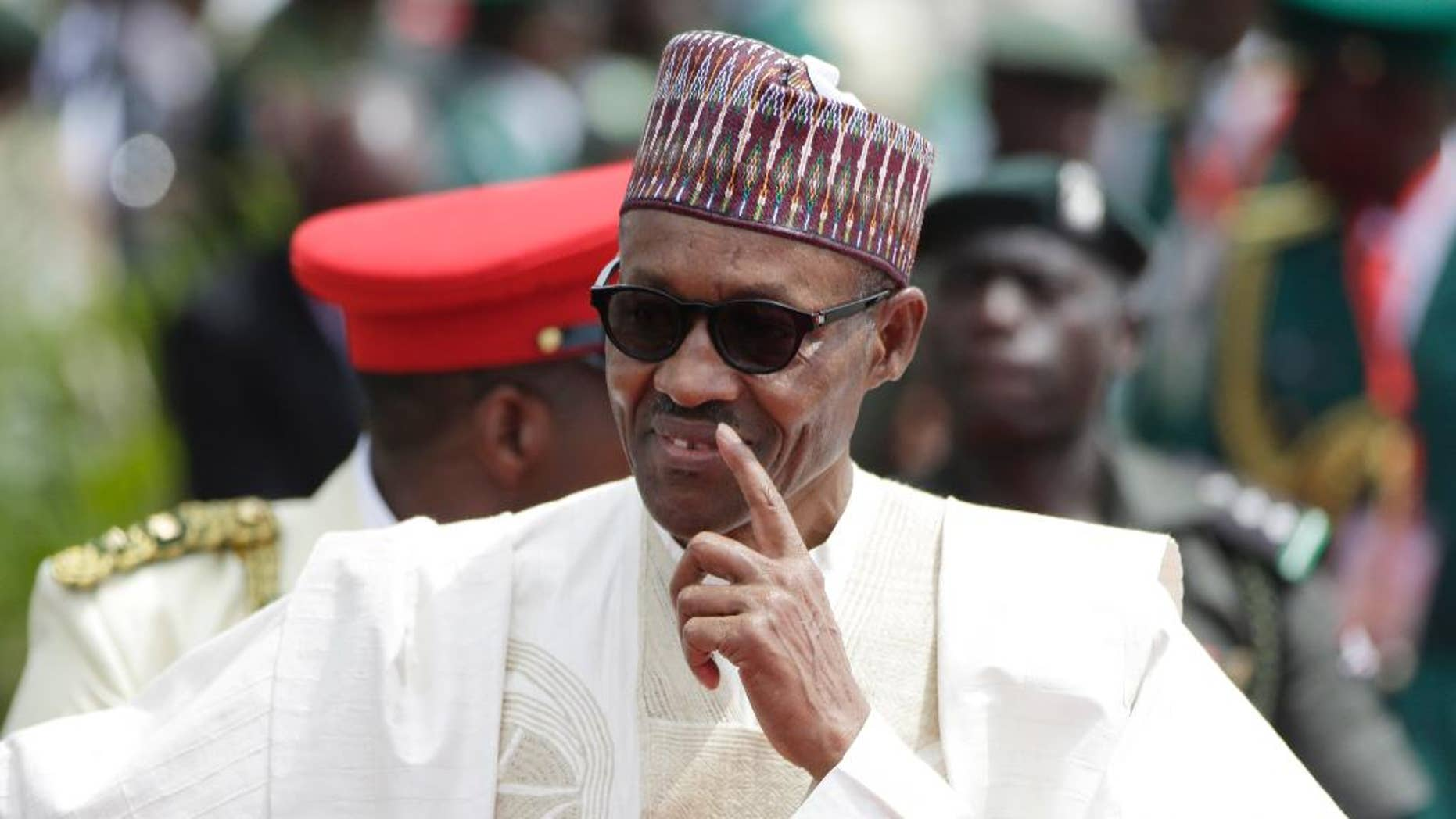 FILE- In this file photo taken Friday, May 29, 2015, former General and Nigerian President, Muhammadu Buhari, arrives for his Inauguration at the eagle square in Abuja, Nigeria. Nigeria's new President Muhammadu Buhari makes his first official visit to one-time enemy Cameroon on Wednesday, July 29, 2015 to ease tensions and bolster support for a regional army to fight the Boko Haram Islamic uprising that is spilling across borders, his spokesman and Cameroon's defense minister said. (AP Photo/Sunday Alamba, File)