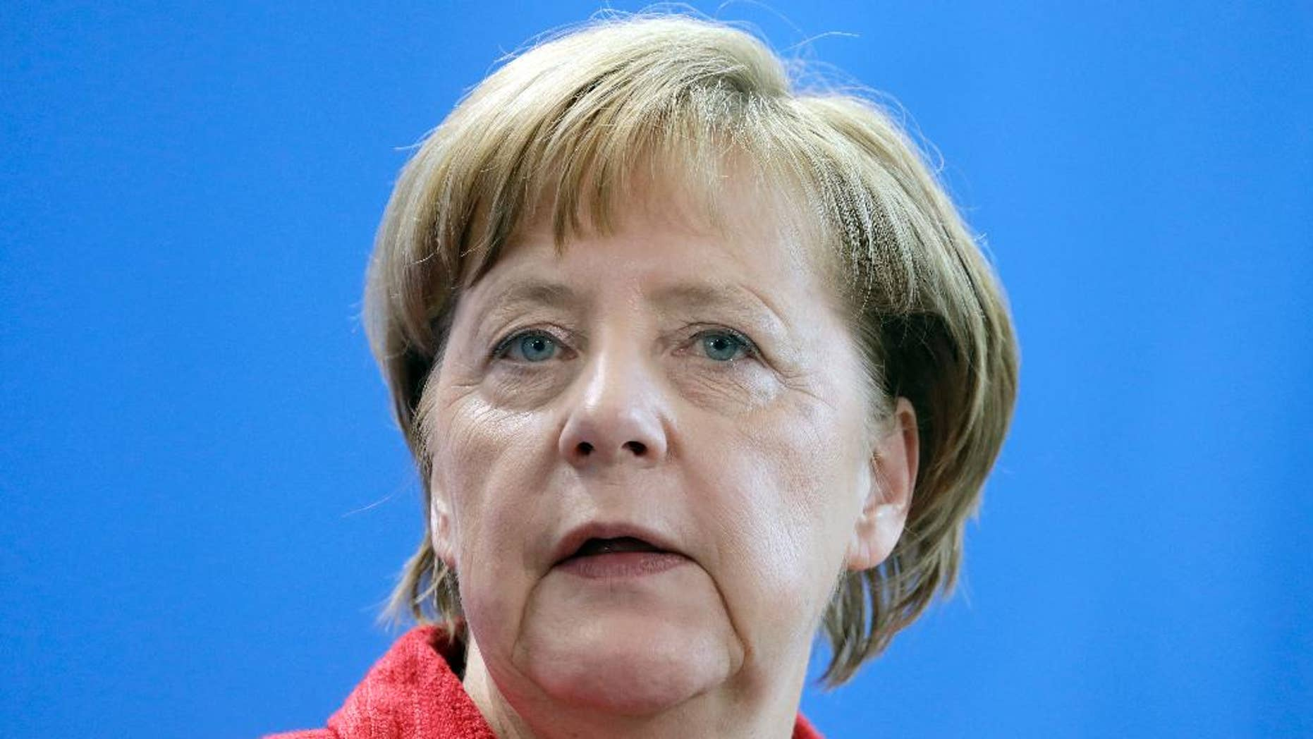 German Chancellor Angela Merkel addresses the media during a joint press conference as part of a meeting with NATO Secretary General Jens Stoltenberg at the chancellery in Berlin, Germany, Thursday, May 11, 2017. (AP Photo/Michael Sohn)