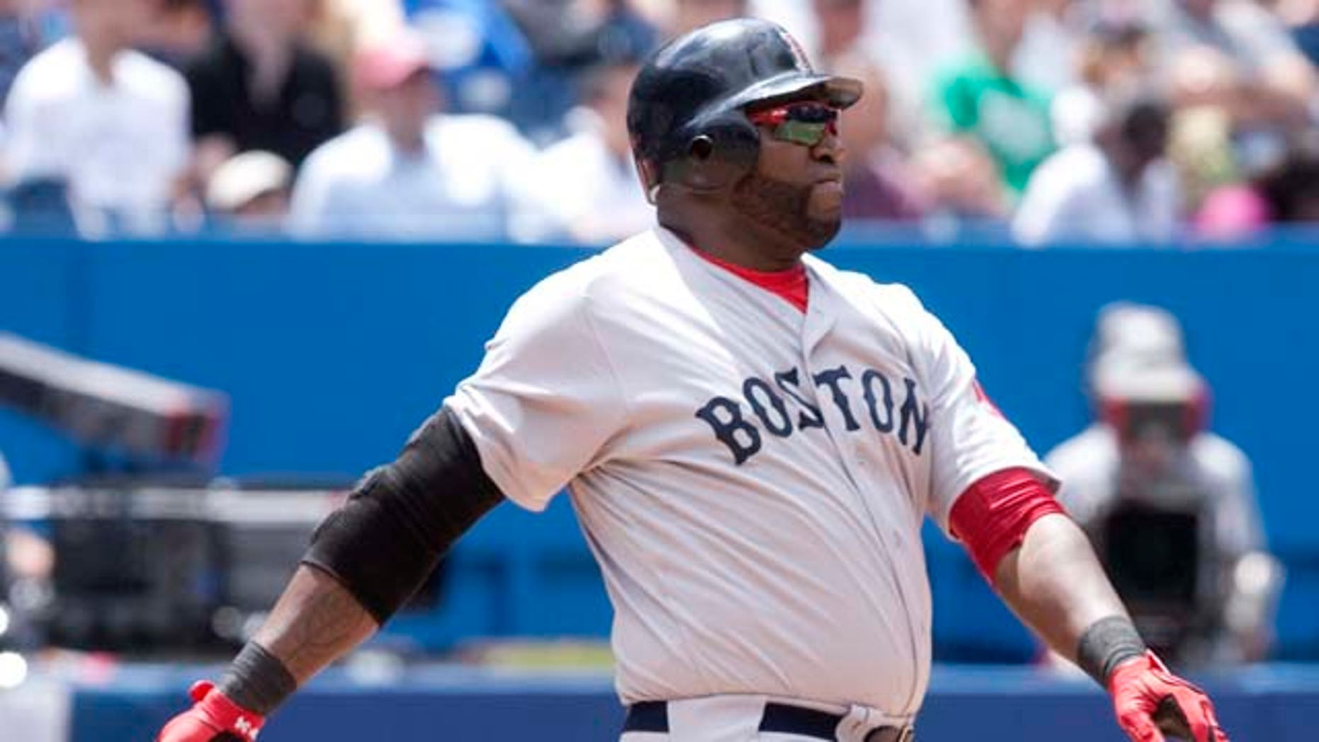 Boston Red Sox's David Ortiz hits a three-run home run in the fifth inning of MLB baseball game action against the Toronto Blue Jays in Toronto, Sunday, June 12, 2011. (AP Photo/The Canadian Press, Darren Calabrese)
