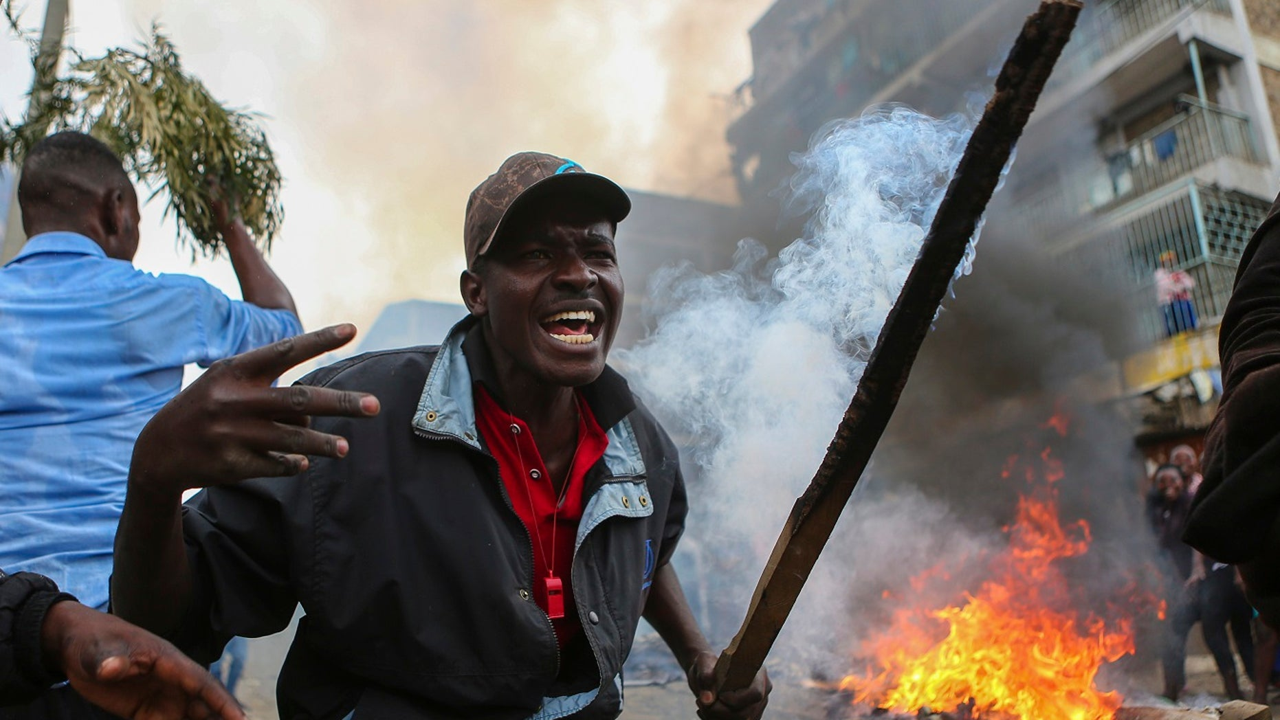 Residents of the Mathare area of Nairobi, Kenya, take to the streets by blocking roads with burning tires to protest in support of Kenyan opposition leader and presidential candidate Ralia Odinga.