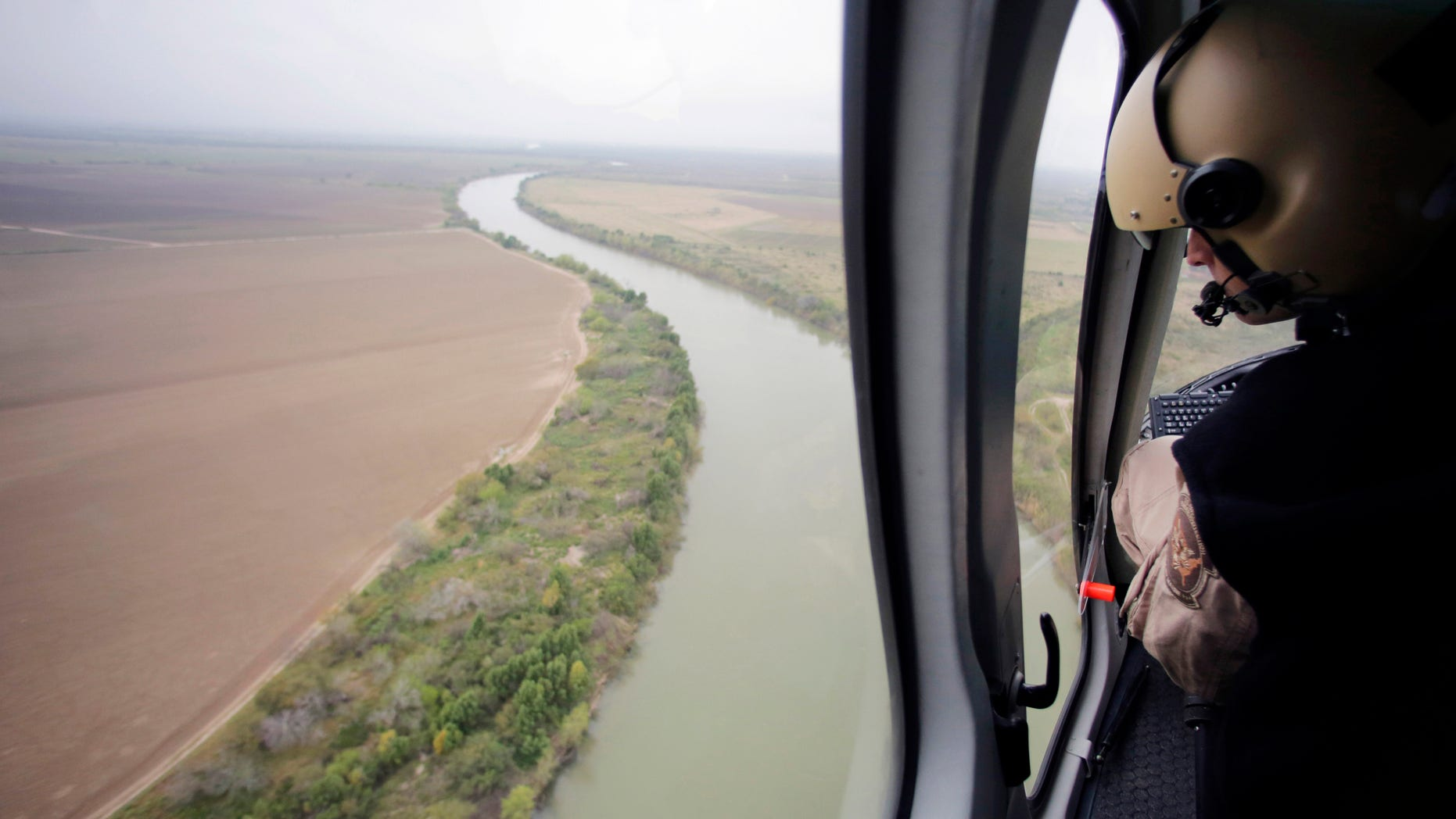 In this Feb. 24, 2015 photo, U.S. Customs and Border Protection Air and Marine agents patrol along the Rio Grande on the Texas-Mexico border near Rio Grande City, Texas. Drowning deaths have spiked since last fall as a surge of law enforcement along the Mexico border prompts immigrants, desperate to avoid detection by a surge of law enforcement, to choose more dangerous and remote crossings into South Texas. (AP Photo/Eric Gay)